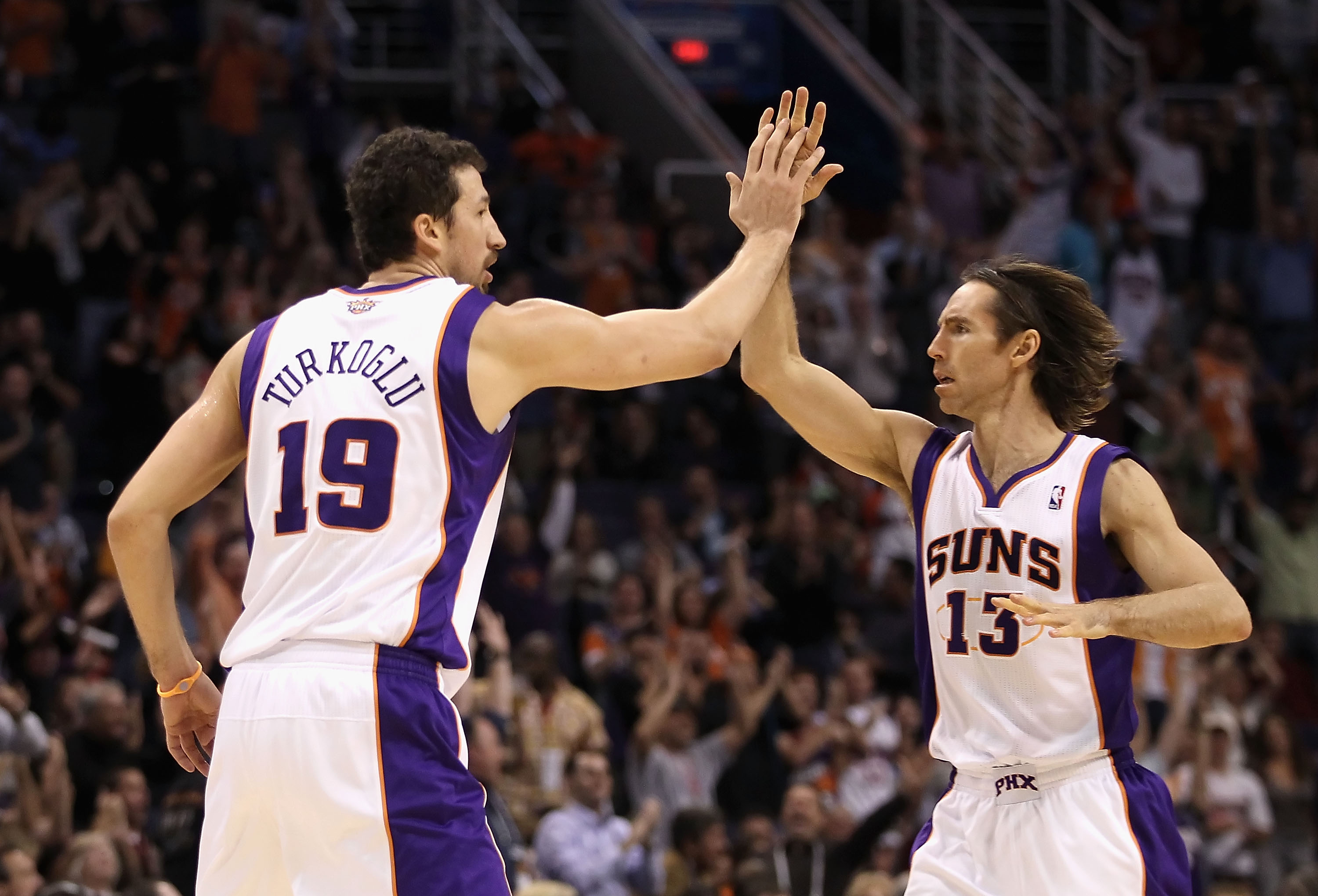 PHOENIX - NOVEMBER 15: Hedo Turkoglu #19 of the Phoenix Suns high-fives teammate Steve Nash #13 after Turkoglu hit a three point shot against the Denver Nuggets during the NBA game at US Airways Center on November 15, 2010 in Phoenix, Arizona. (Photo by Christian Petersen/Getty Images)