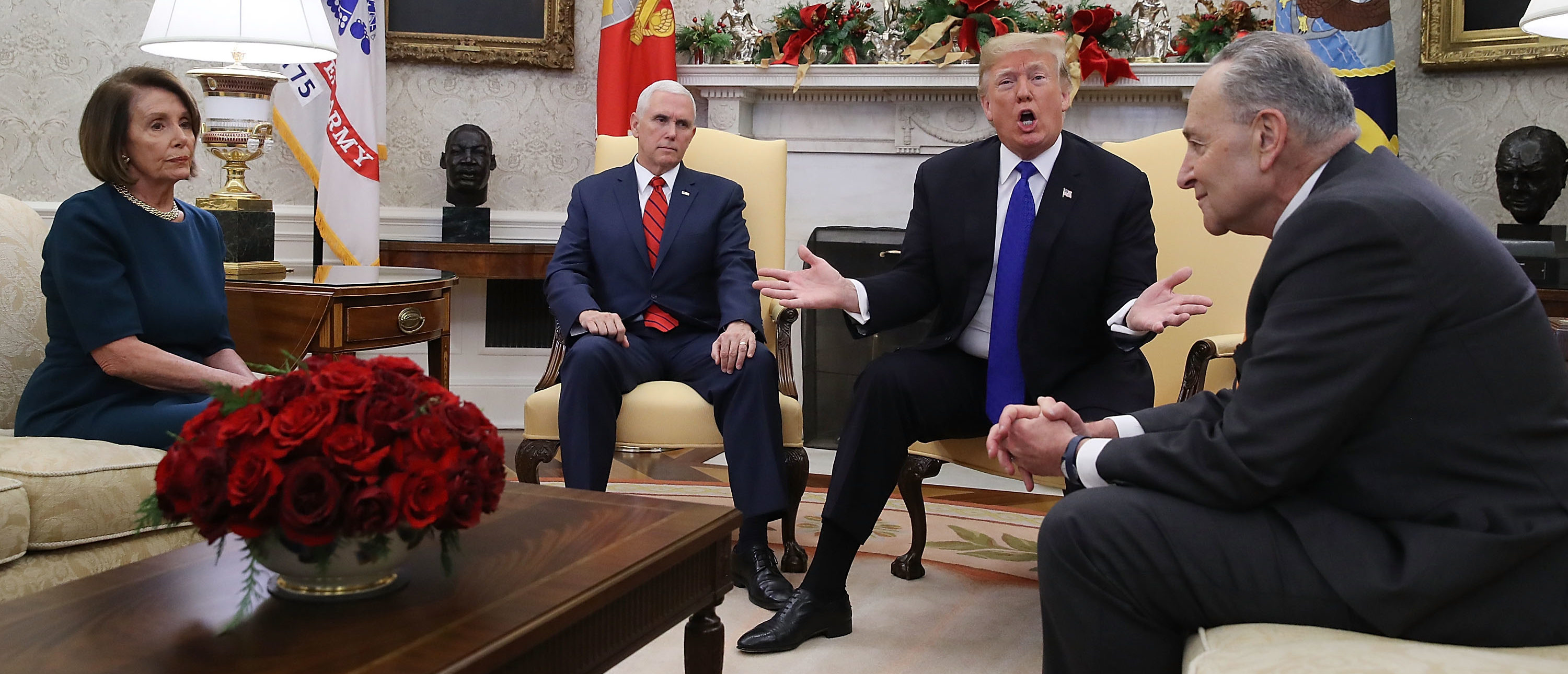 U.S. President Donald Trump (2R) argues about border security with Senate Minority Leader Chuck Schumer (D-NY) (R) and House Minority Leader Nancy Pelosi (D-CA) as Vice President Mike Pence sits nearby in the Oval Office on December 11, 2018 in Washington, DC. (Photo by Mark Wilson/Getty Images)
