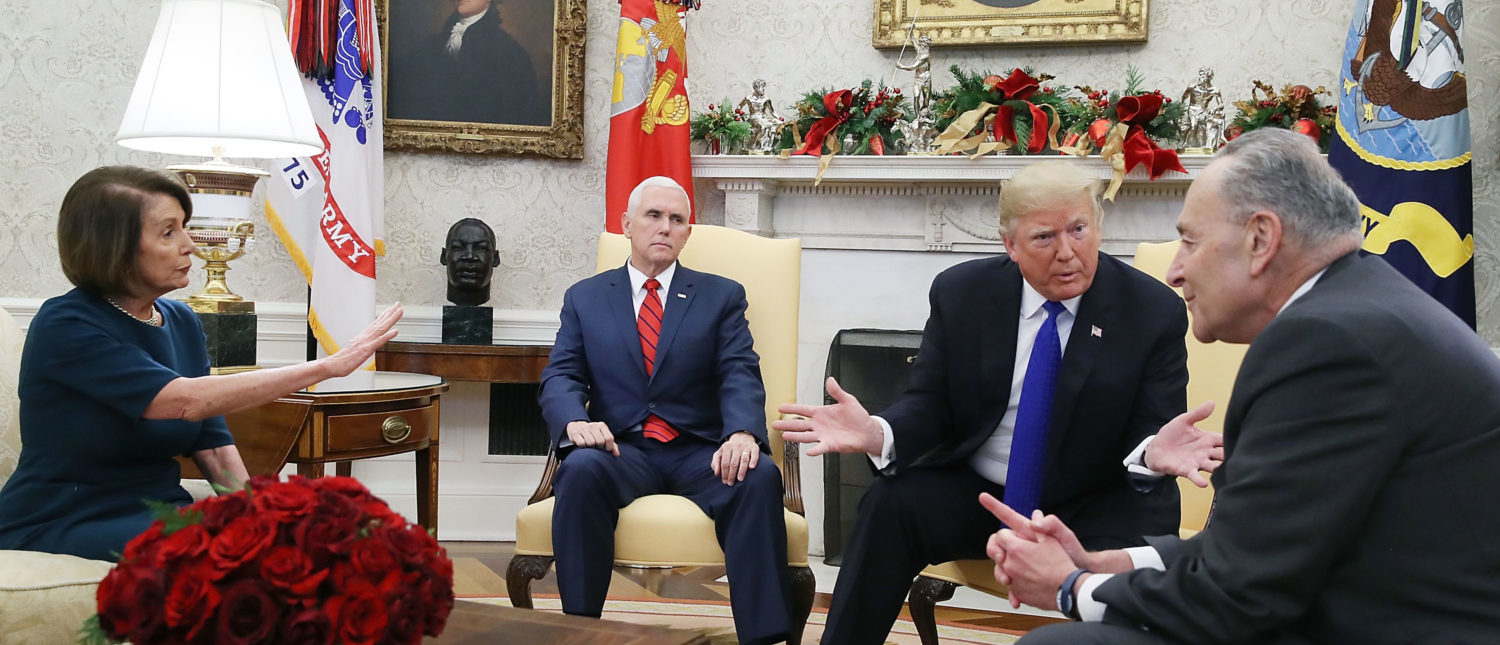 WASHINGTON, DC - DECEMBER 11: U.S. President Donald Trump (2R) argues about border security with Senate Minority Leader Chuck Schumer (D-NY) (R) and House Minority Leader Nancy Pelosi (D-CA) as Vice President Mike Pence sits nearby in the Oval Office on December 11, 2018 in Washington, DC. (Photo by Mark Wilson/Getty Images)