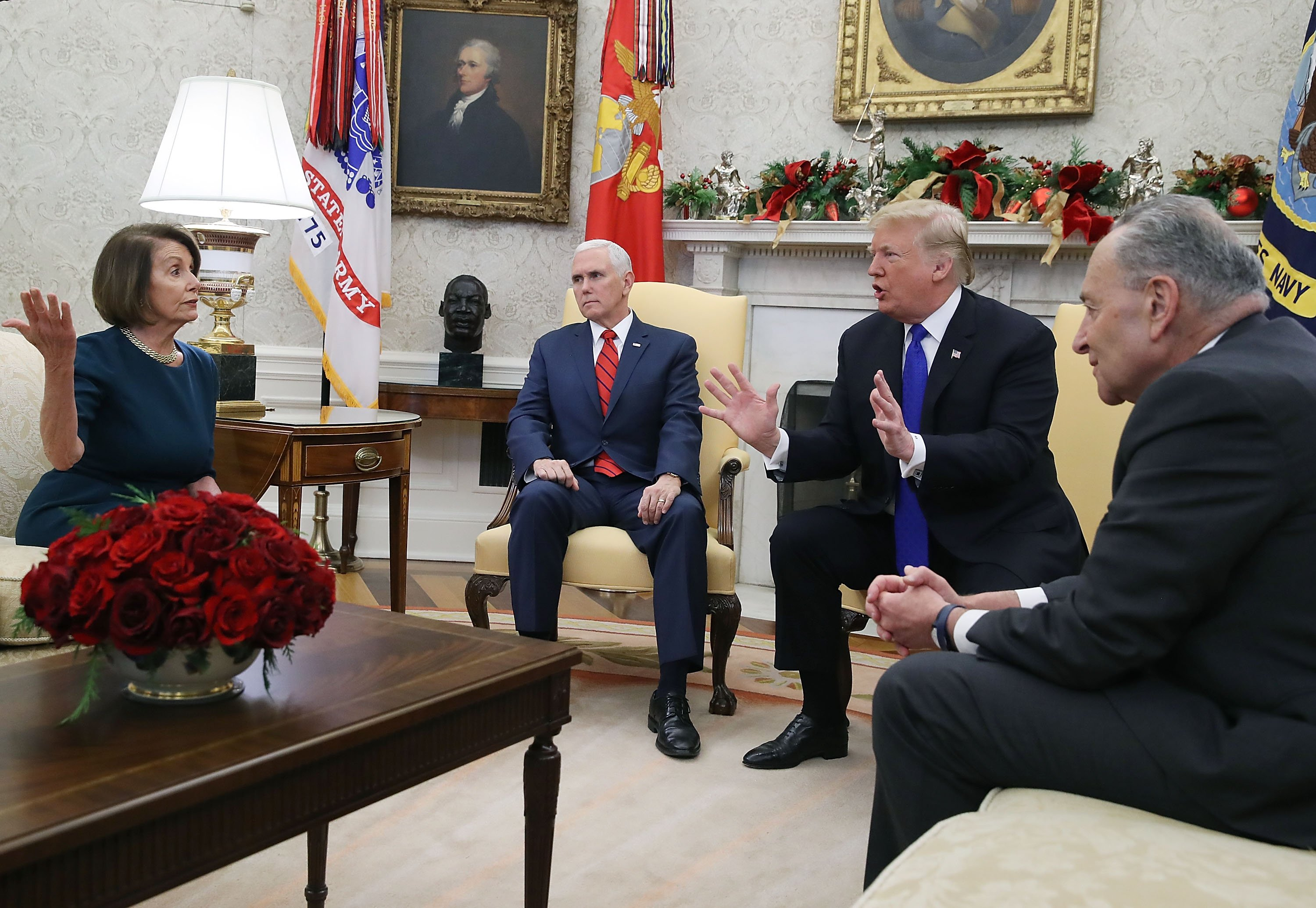 U.S. President Donald Trump (2R) argues about border security with Senate Minority Leader Chuck Schumer (R) and House Minority Leader Nancy Pelosi as Vice President Mike Pence sits nearby in the Oval Office on December 11, 2018 in Washington, DC. (Photo by Mark Wilson/Getty Images)