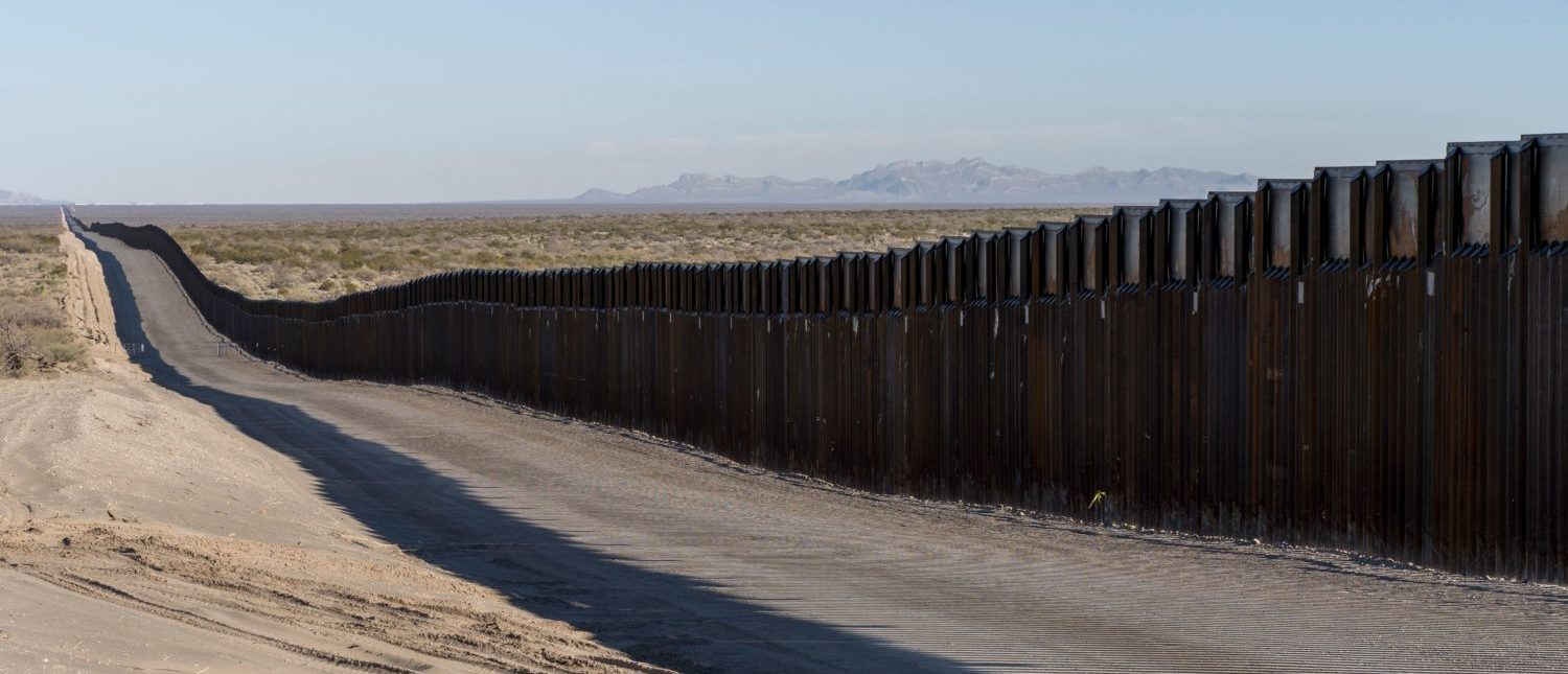TOPSHOT - This photo shows the border fence near New Mexico's Highway 9, near Santa Teresa on December 23, 2018. - The US government began a Christmastime shutdown early on December 22, after Congress adjourned without passing a federal spending bill or addressing President Donald Trump's demand for money to build a border wall. (Photo by PAUL RATJE/AFP/Getty Images)