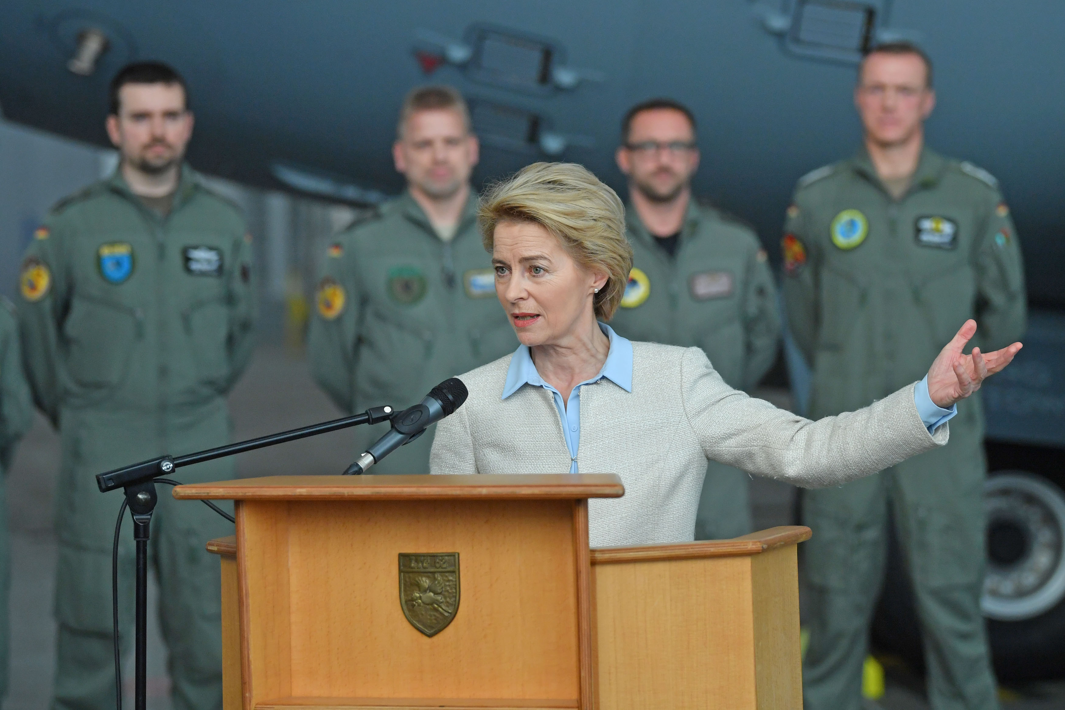 German Defense Minister Ursula von der Leyen stands in front of an Airbus A400M military transport plane of the Luftwaffe, the German air force, as she speaks to the media on January 2, 2019 in Wunstorf, Germany. (Photo by Thomas Starke/Getty Images)
