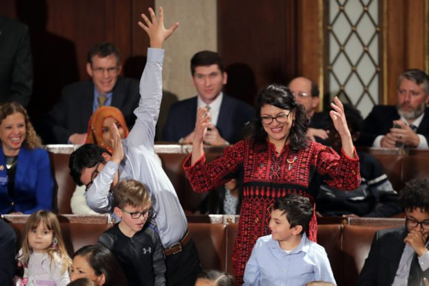 WASHINGTON, DC - JANUARY 3: Rep.-elect Rashida Tlaib (D-MI) votes for Speaker-designate Rep. Nancy Pelosi (D-CA) along with her kids during the first session of the 116th Congress at the U.S. Capitol January 03, 2019 in Washington, DC. Under the cloud of a partial federal government shutdown, Pelosi will reclaim her former title as Speaker of the House and her fellow Democrats will take control of the House of Representatives for the second time in eight years. (Photo by Chip Somodevilla/Getty Images)