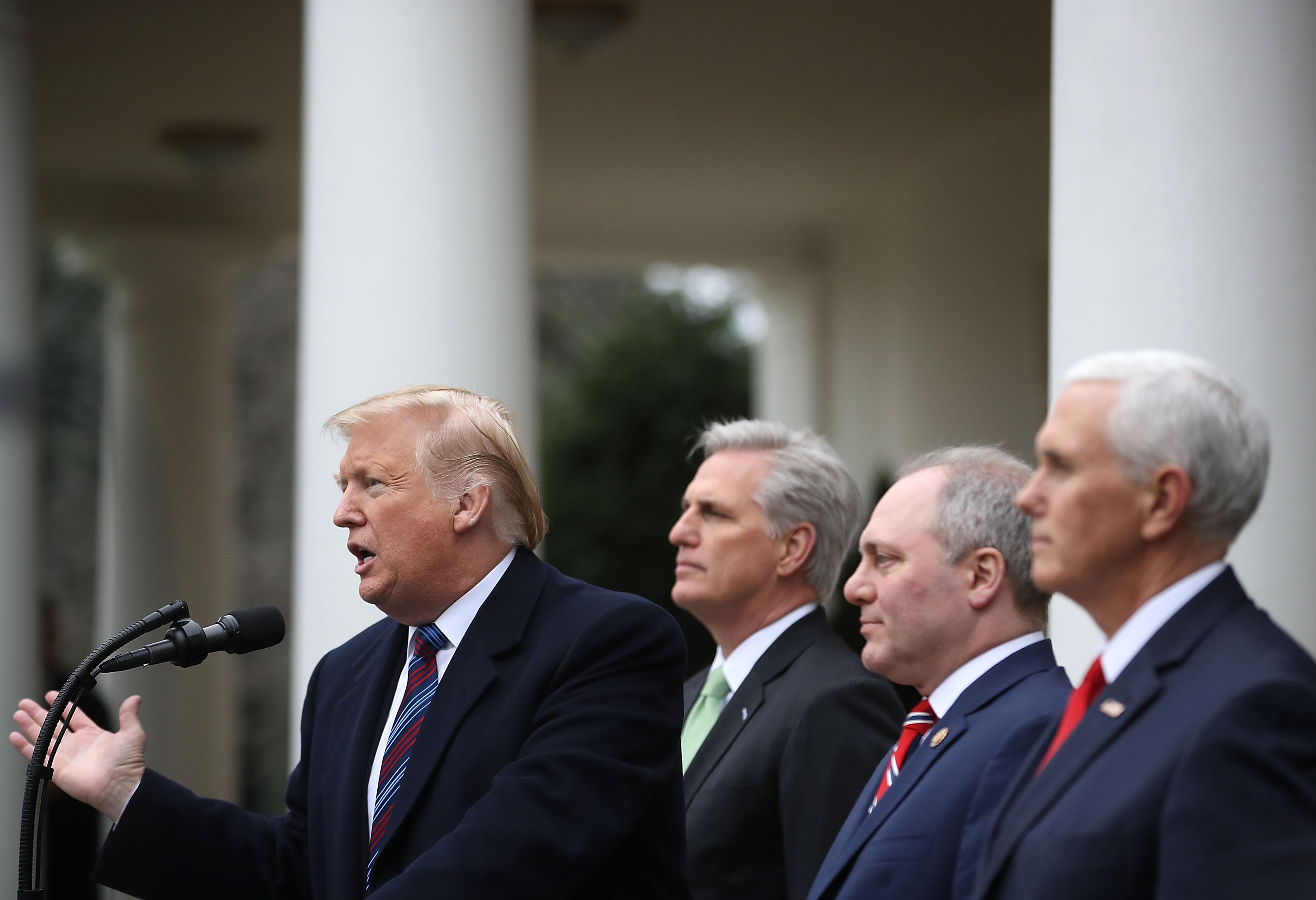 WASHINGTON, DC - JANUARY 04: U.S. President Donald Trump (L) is flanked by Vice President Mike Pence (R), House Minority Leader Kevin McCarthy (R-CA) and Rep. Steve Scalise (R-LA) while speaking to the media after a meeting with Congressional leaders about ending the partial government shutdown, in the Rose Garden at the White House on January 4, 2019 in Washington, DC. The U.S government is going into the 13th day of a partial shutdown with Republicans and Democrats at odds on agreeing with President Donald Trump's demands for more money to build a wall along the U.S.-Mexico border.