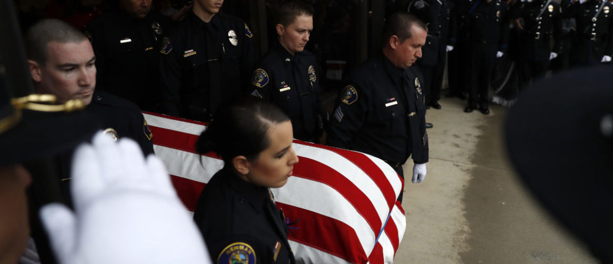 MODESTO, CA - JANUARY 05: Officers with the Newman Police Department carry the flag-draped casket of slainofficer Corporal Ronil Singh during a funeral service at CrossPoint Community Church on January 5, 2019 in Modesto, California. Hundreds of police officers from across the country along with members of the public came out to pay their respects after Cpl. Singh was shot and killed by an undocumented immigrant on December 26 following a traffic stop of a fugitive parolee. (Photo by Stephen Lam/Getty Images)