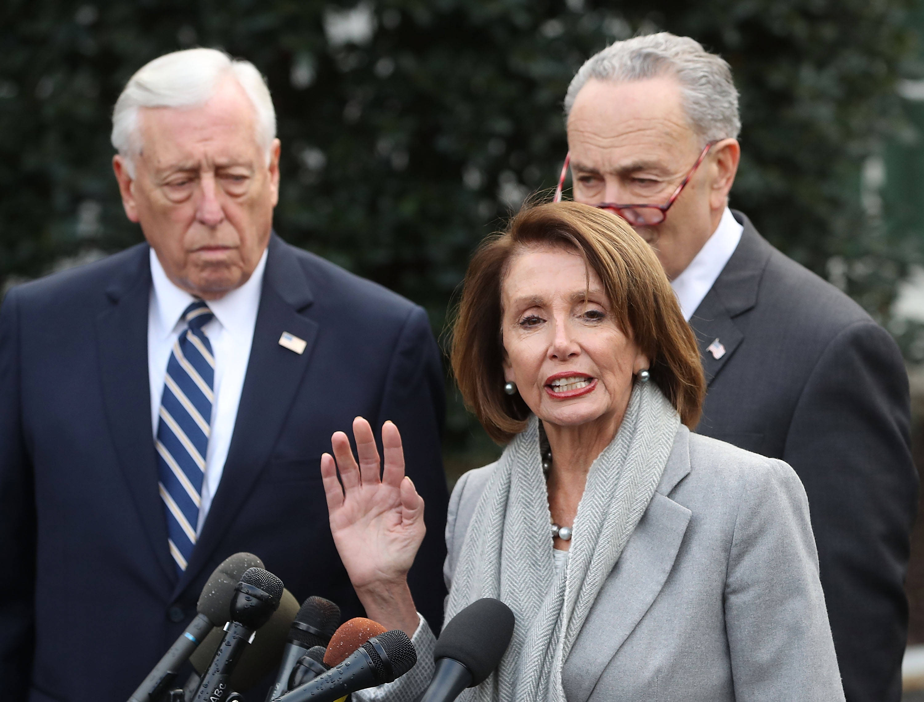 House Speaker Nancy Pelosi speaks while flanked by House Majority Leader Steny Hoyer (L) and Senate Minority Leader Charles Schumer, at the White House after meeting with U.S. President Donald Trump about ending the partial government shutdown, on January 9, 2019 in Washington, DC. (Photo by Mark Wilson/Getty Images)