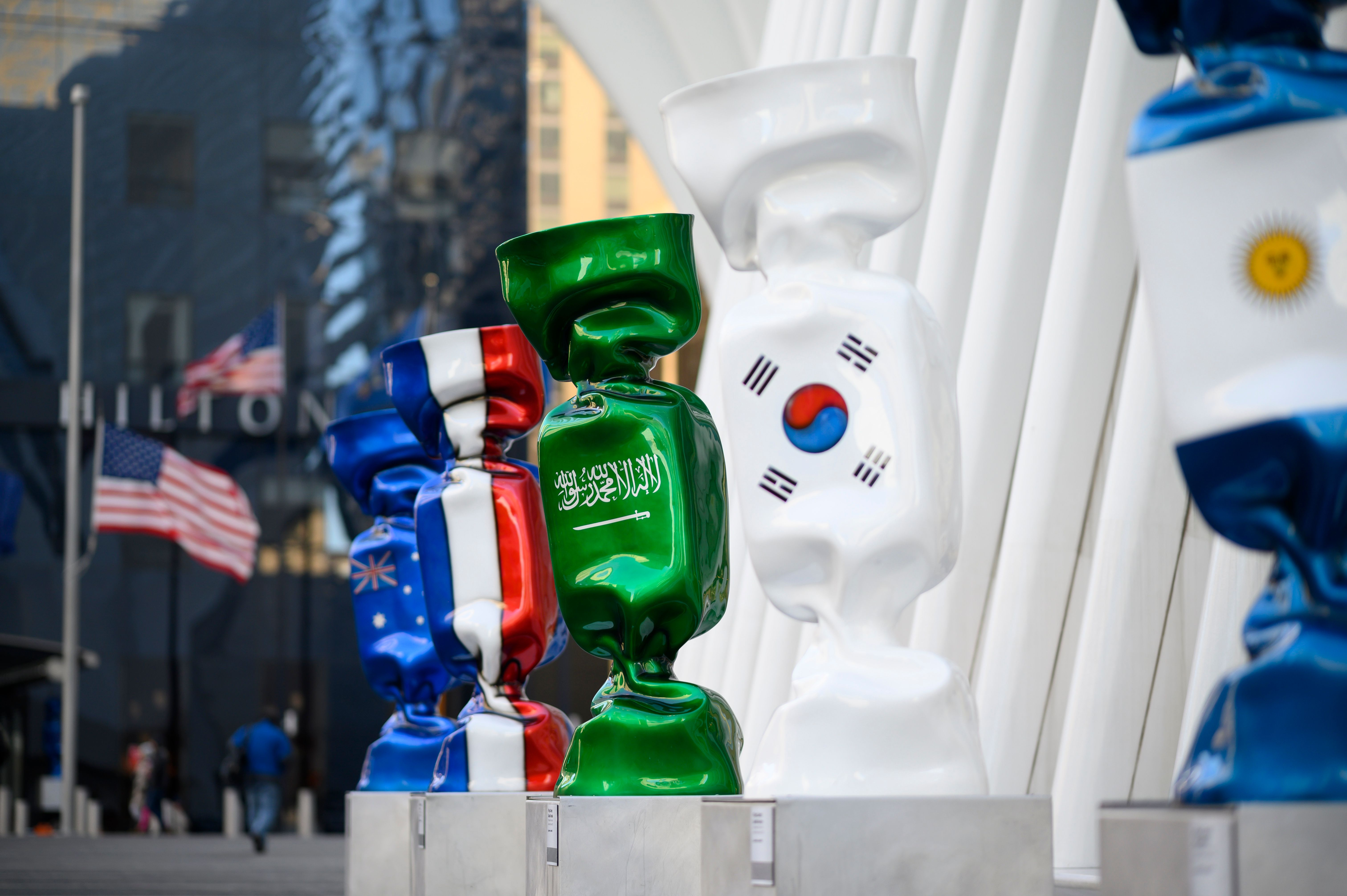 A sculpture with the flag of Saudi Arabia(3rdR), part of an exhibit called 'Candy Nations' is pictured outside next to the Oculus, one of the buildings that replaced the original World Trade Center on January 14, 2019 in New York City. - Candy Nations depicting the flags of each of the G20 countries as 9-foot-tall wrapped confections, has drawn criticism for its placement outside 1 World Trade Center. (Photo by Johannes EISELE / AFP)