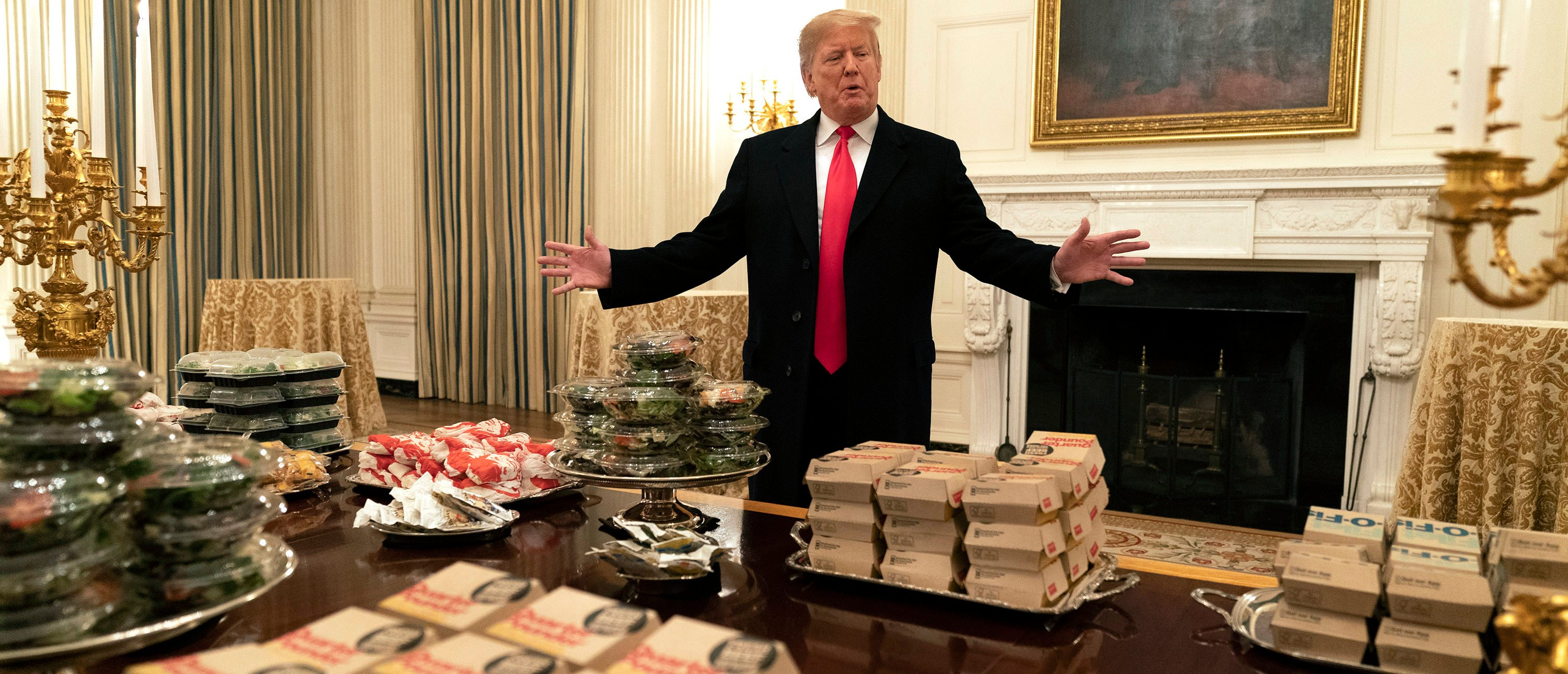 WASHINGTON, DC - JANUARY 14: (AFP OUT) U.S President Donald Trump presents fast food to be served to the Clemson Tigers football team to celebrate their Championship at the White House on January 14, 2019 in Washington, DC. (Photo by Chris Kleponis-Pool/Getty Images)