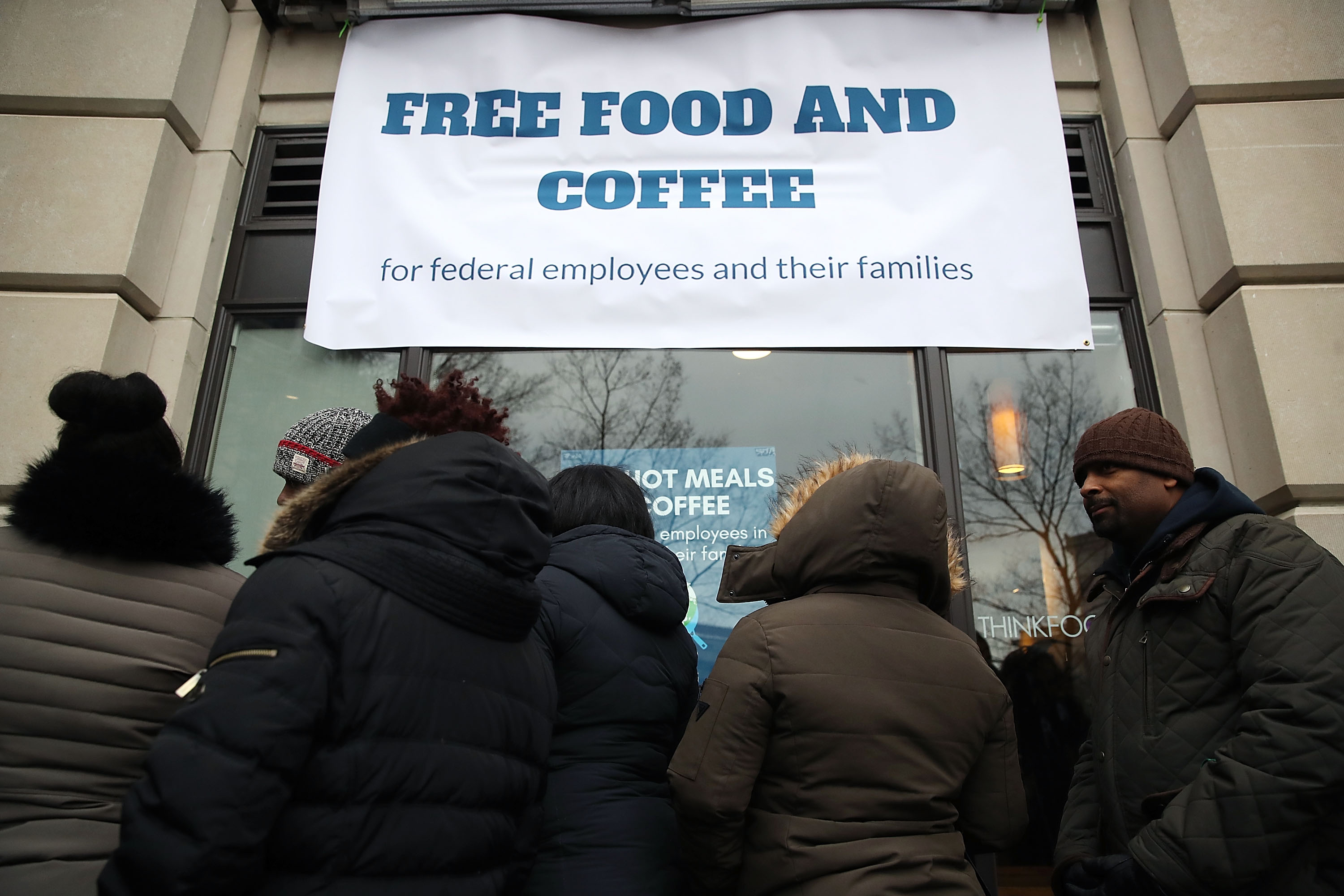 WASHINGTON, DC - JANUARY 16: People line up to get a free lunch at a pop-up eatery hosted by Celebrity Chef Jose Andres for furloughed government employees and their families, on January 16, 2019 in Washington, DC. The U.S. government is in the 26th day of a partial shutdown. (Photo by Mark Wilson/Getty Images)