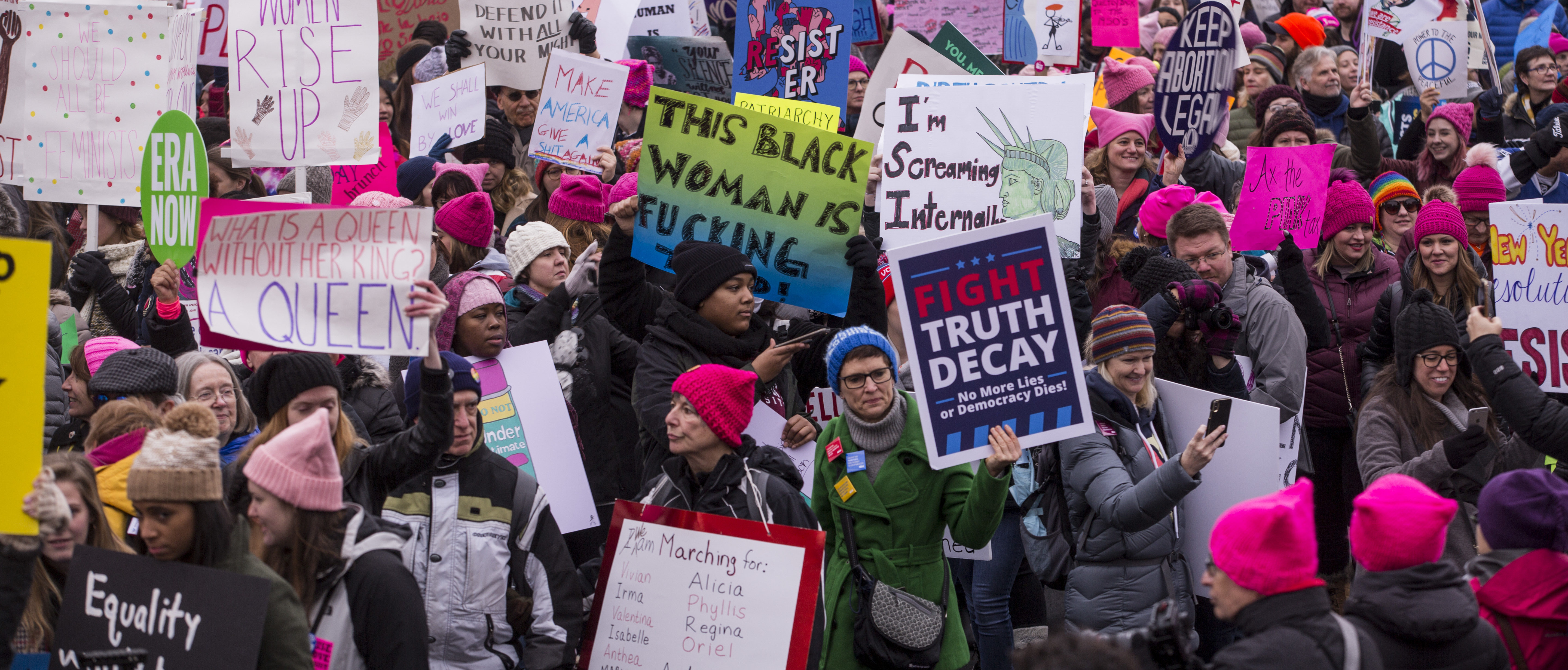 WASHINGTON, DC - JANUARY 19: Demonstrators hold signs during the 2019 Women's March on January 19, 2019 in Washington, DC. Demonstrations are slated to take place in cities across the country in the third annual event aimed to highlight social change and celebrate women's rights around the world. (Photo by Zach Gibson/Getty Images)