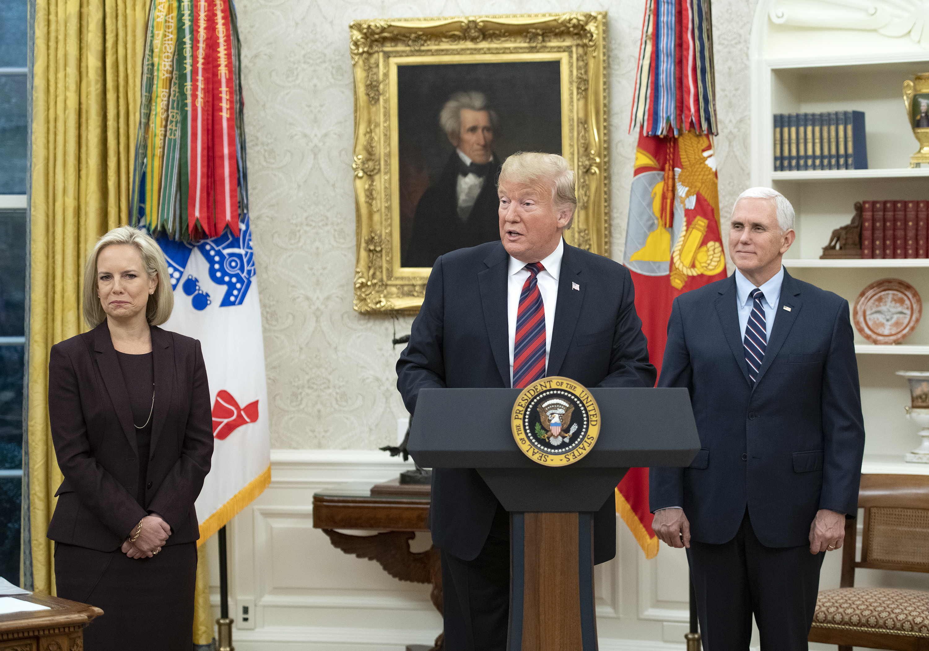 U.S. President Donald Trump, center, makes remarks as he hosts a naturalization ceremony in the Oval Office of the White House in Washington, DC, January 19, 2019. (Photo by Ron Sachs-Pool/Getty Images)