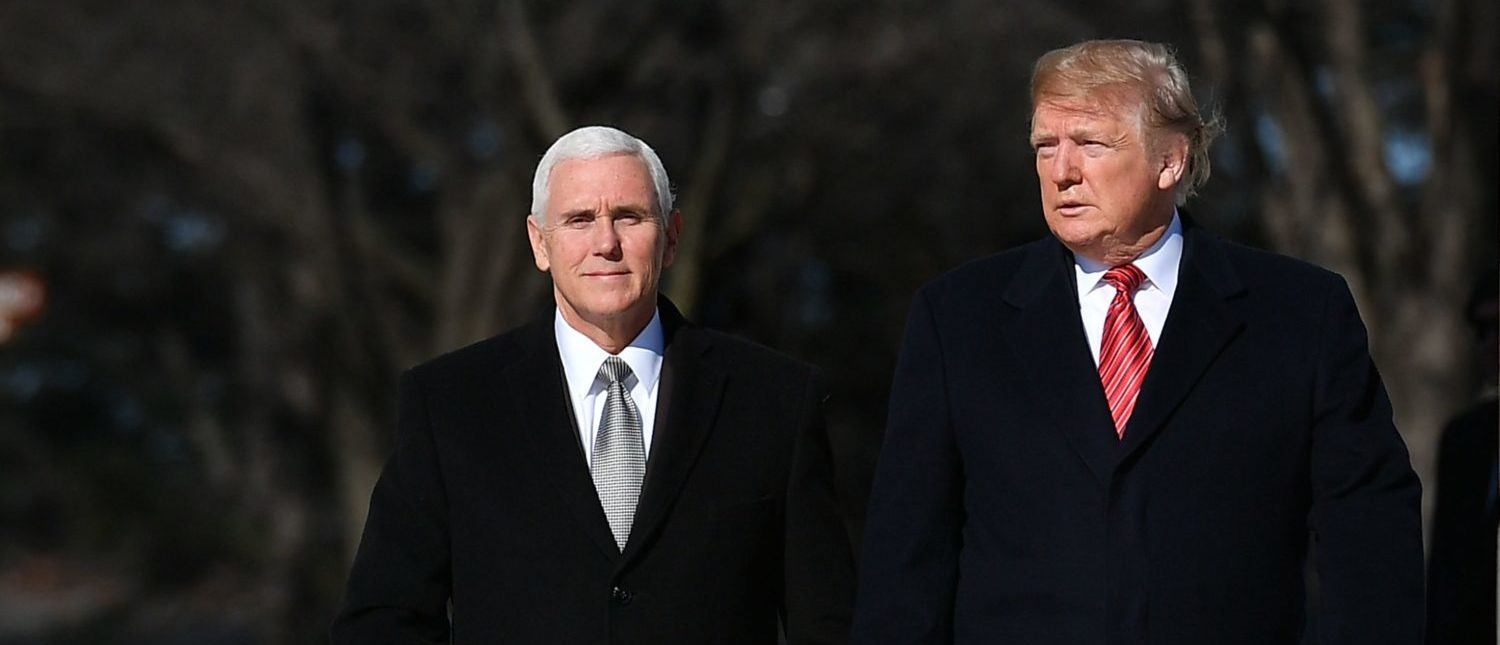 US President Donald Trump and US Vice President Mike Pence(L) visit the Martin Luther King Jr. Memorial in Washington, DC on Martin Luther King Day on January 21, 2019. (Photo by MANDEL NGAN/AFP/Getty Images)