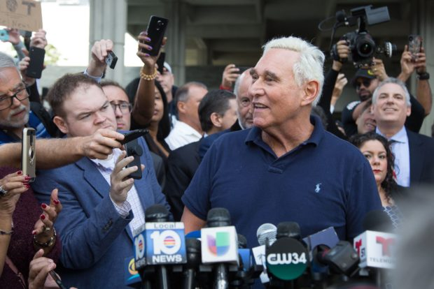 "Roger Stone, a longtime adviser to US President Donald Trump, speaks to the media outside court January 25, 2019 in Fort Lauderdale, Florida. - Stone was taken into custody by heavily armed police in a predawn raid at his home in Fort Lauderdale, Florida after an indictment was unsealed in Washington by Special Counsel Robert Mueller. He appeared in Fort Lauderdale court in handcuffs charged with seven counts, including obstruction of justice, making false statements to Congress and witness tampering. ""I will plead not guilty to these charges. I will defeat them in court. I believe this is a politically-motivated investigation,"" Stone said as he emerged from court. (Photo by Joshua Prezant / AFP) (Photo credit should read JOSHUA PREZANT/AFP/Getty Images)"