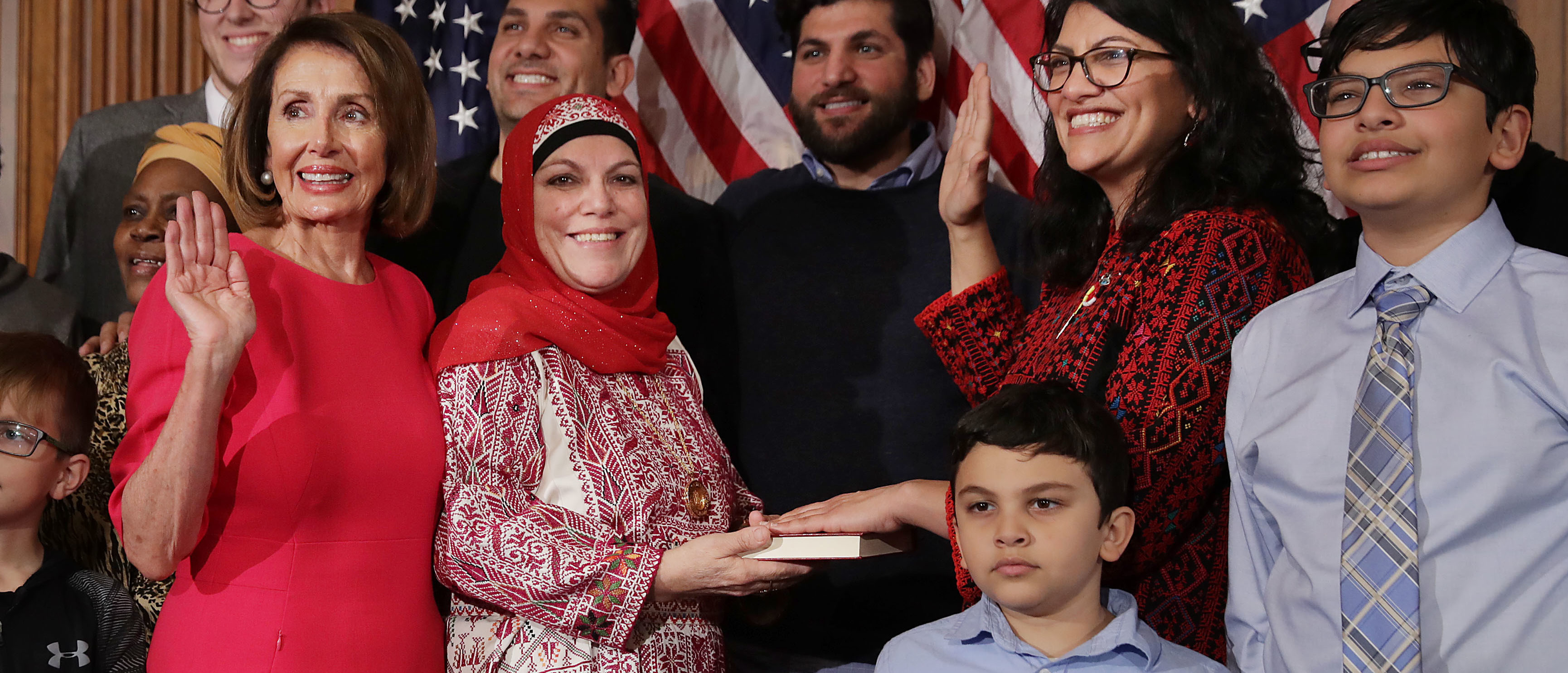 WASHINGTON, DC - JANUARY 03: Speaker of the House Nancy Pelosi (D-CA) poses for photographs with Rep. Rashida Tlaib (D-MI) and her family in the Rayburn Room at the U.S. Capitol January 03, 2019 in Washington, DC. Under the cloud of a partial federal government shutdown, Pelosi reclaimed her former title as speaker and her fellow Democrats took control of the House of Representatives for the second time in eight years. (Photo by Chip Somodevilla/Getty Images)