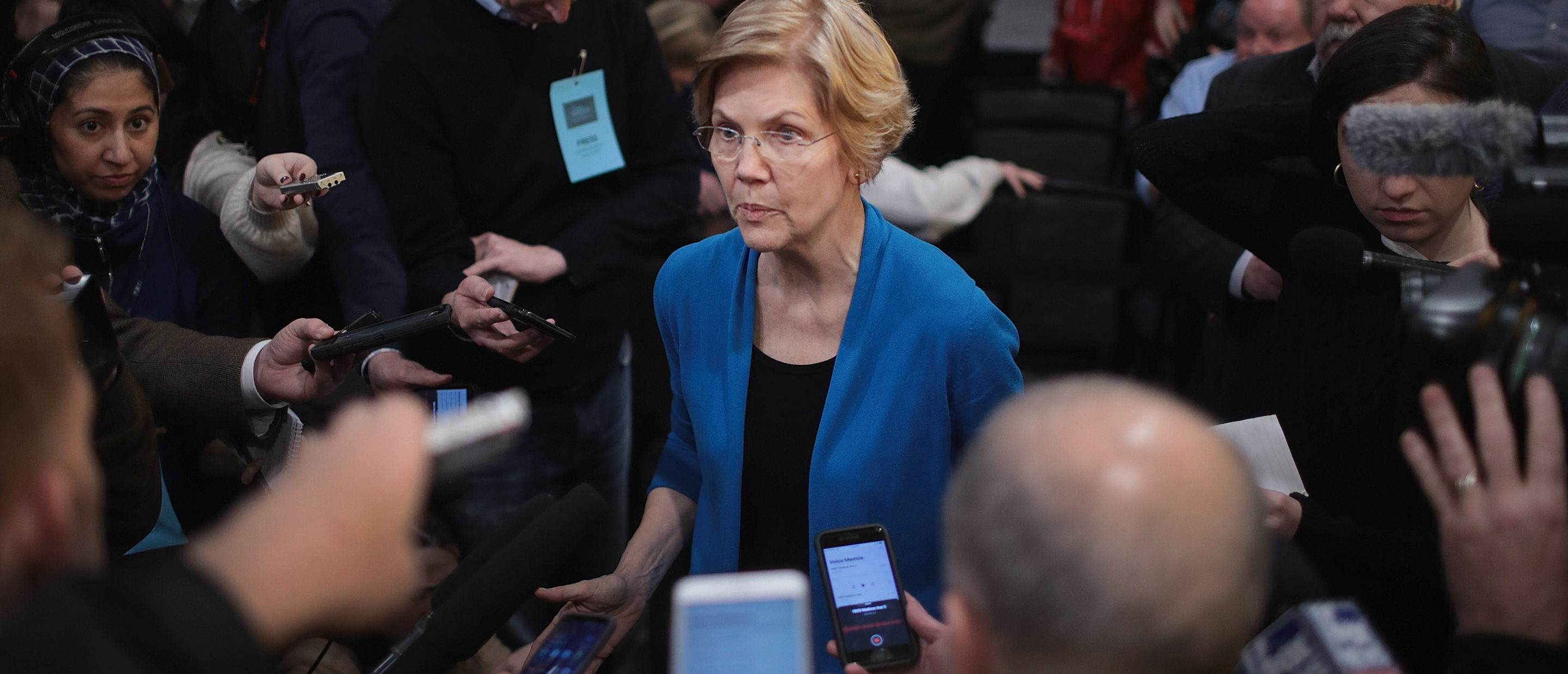 Sen. Elizabeth Warren (D-MA) speaks to reporters during a campaign stop at McCoy's Bar Patio and Grill on January 4, 2019 in Council Bluffs, Iowa. (Photo by Scott Olson/Getty Images)