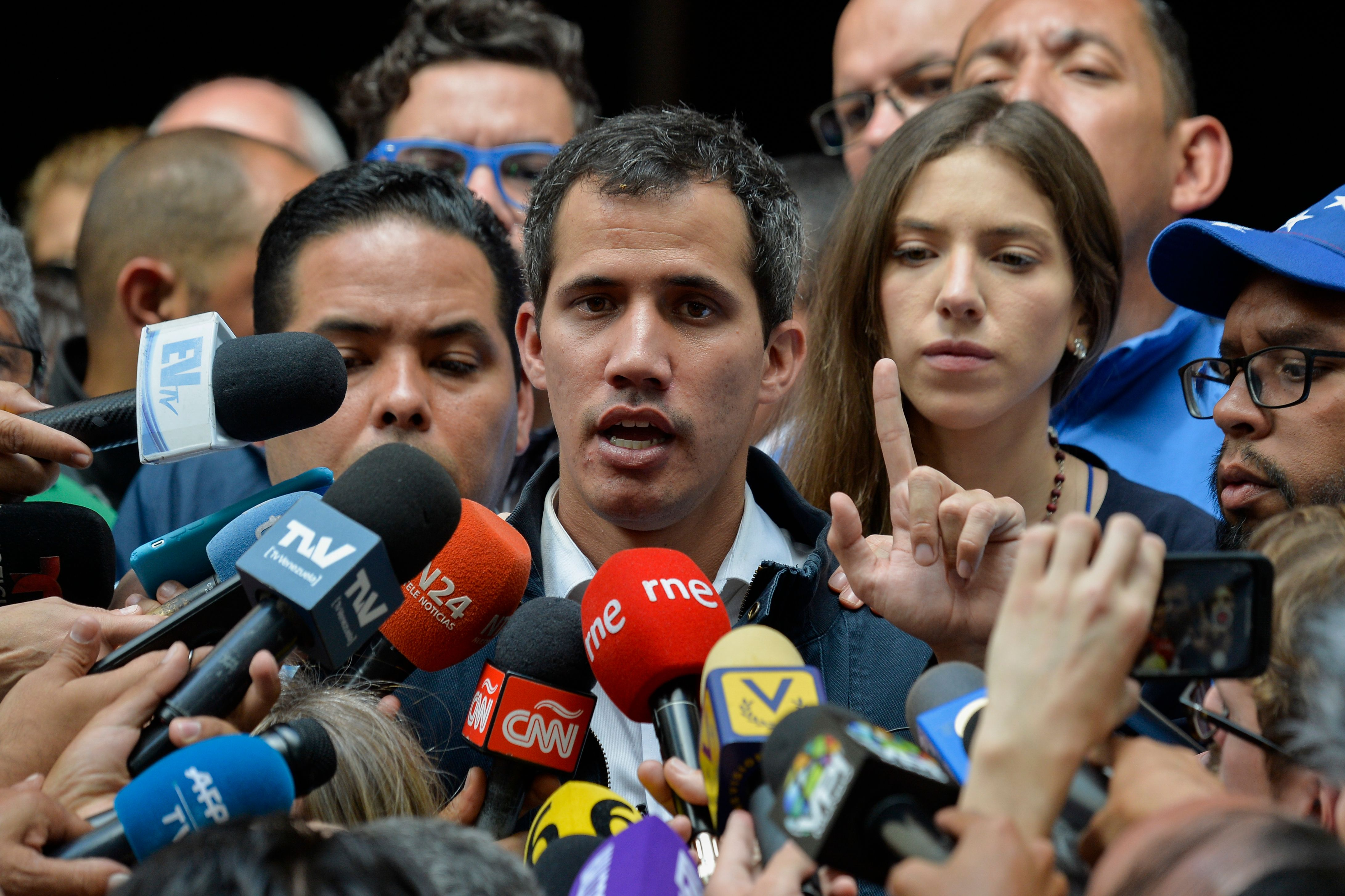 "Venezuela's National Assembly head and self-proclaimed ""acting president"" Juan Guaido speaks to the press after attending a mass in honour to the fallen in the fight for freedom, political prisoners and the exiled, at the San Jose church in Caracas on January 27, 2019. - Guaido, who has galvanized a previously divided opposition, is offering an amnesty approved by the opposition-controlled National Assembly to anyone in the military who disavows President Nicolas Maduro, even suggesting amnesty for Maduro himself. (Photo by LUIS ROBAYO/AFP/Getty Images)"