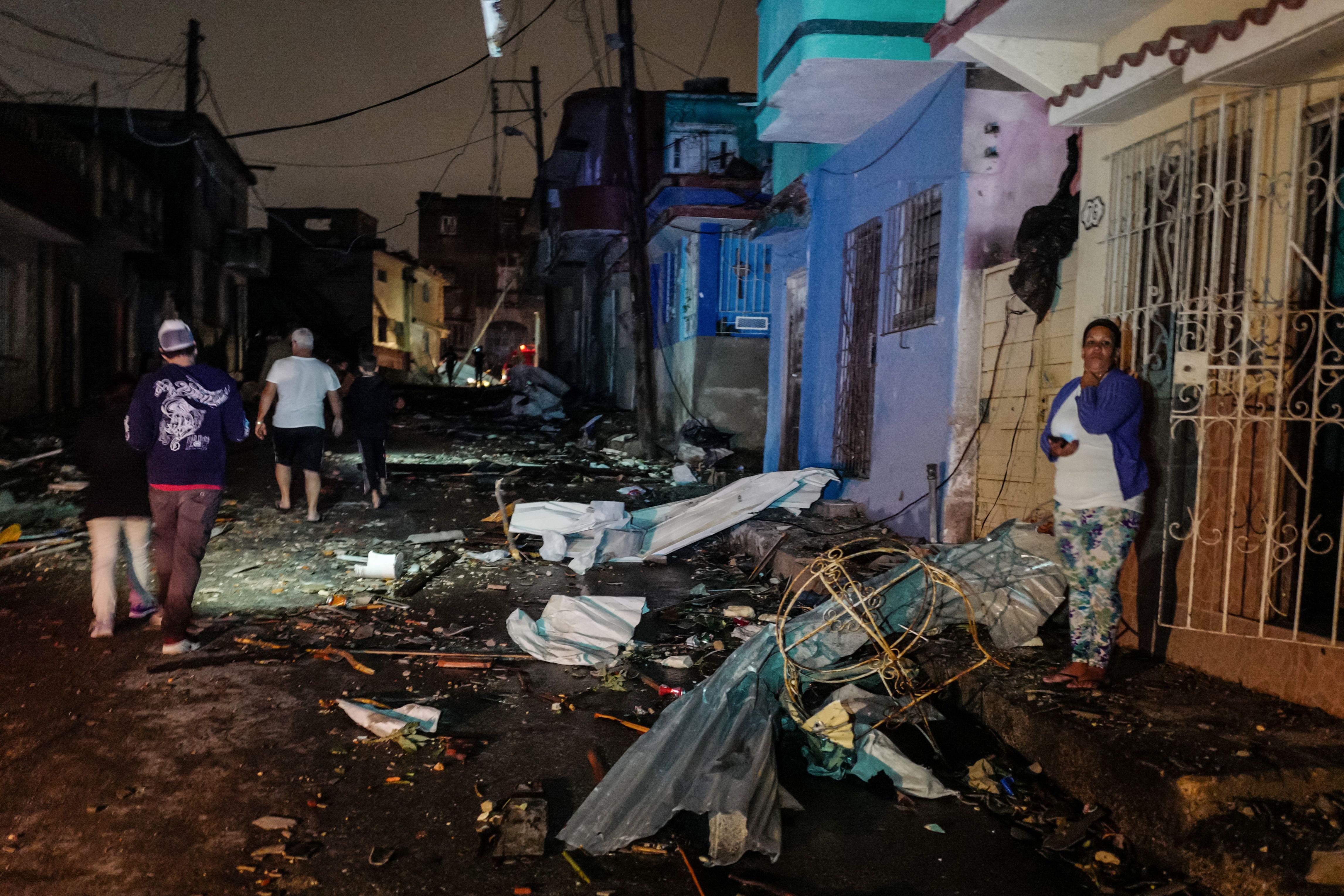 Cubans walk past debris in the tornado-hit Luyano neighbourhood in Havana early on January 28, 2019. (ADALBERTO ROQUE/AFP/Getty Images)