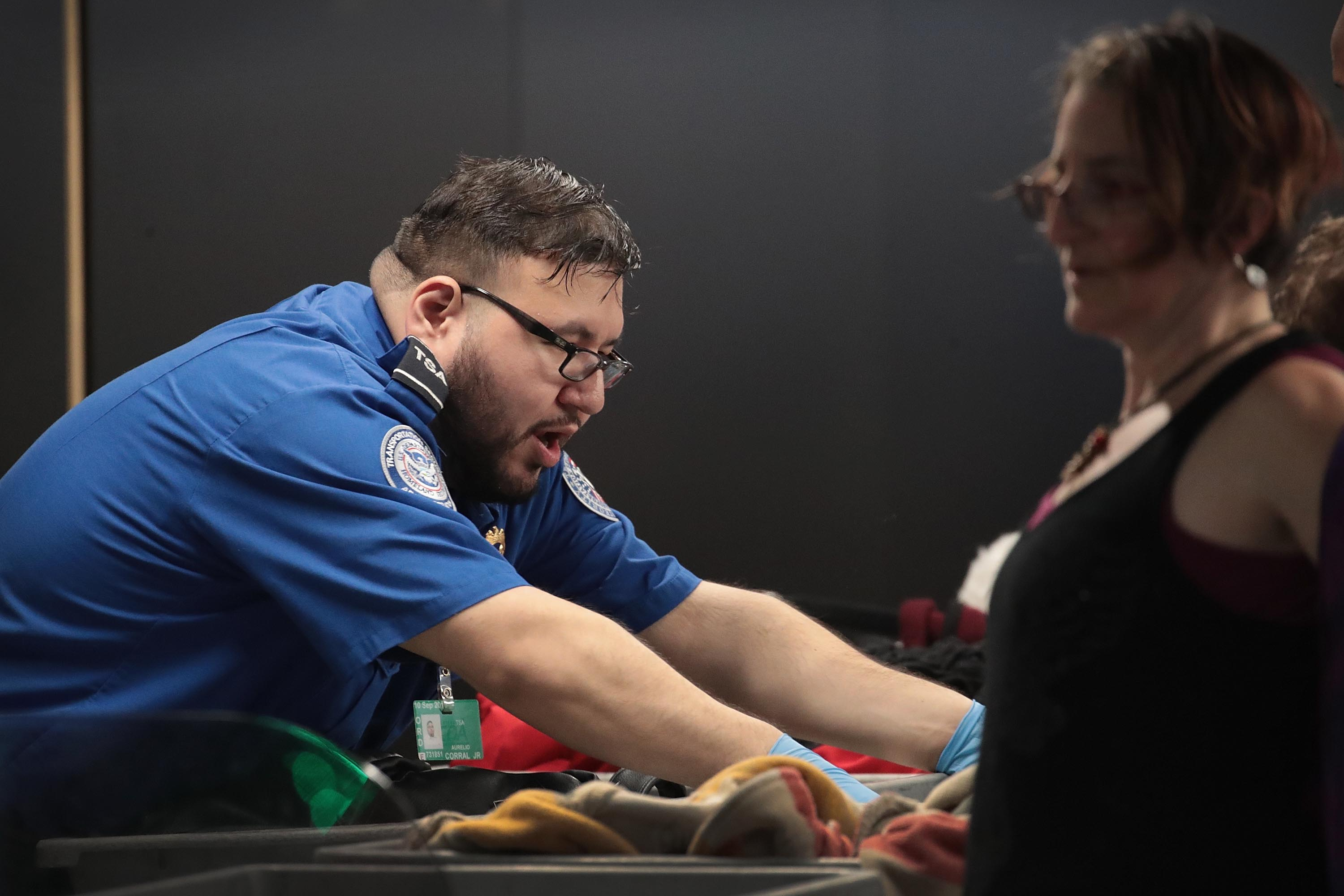 A Transportation Security Administration (TSA) worker screens passengers and airport employees at O'Hare International Airport on January 07, 2019 in Chicago, Illinois. (Photo by Scott Olson/Getty Images)