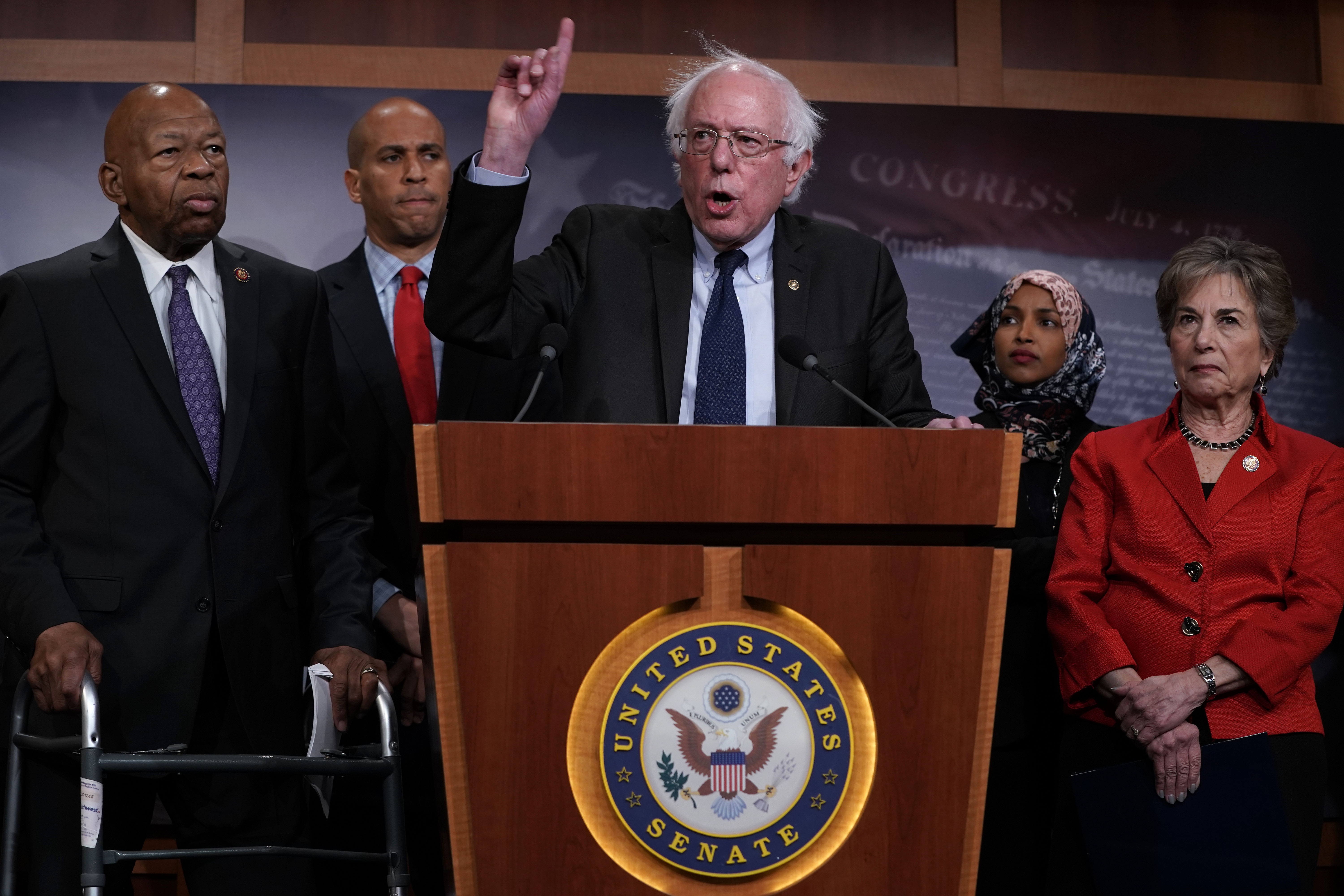 U.S. Sen. Bernie Sanders (3rd L) speaks as (L-R) Rep. Elijah Cummings Sen. Cory Booker, Rep. Ilhan Omar, and Rep. Jan Schakowsky listen during a news conference on prescription drugs January 10, 2019 at the Capitol in Washington, DC. (Photo by Alex Wong/Getty Images)