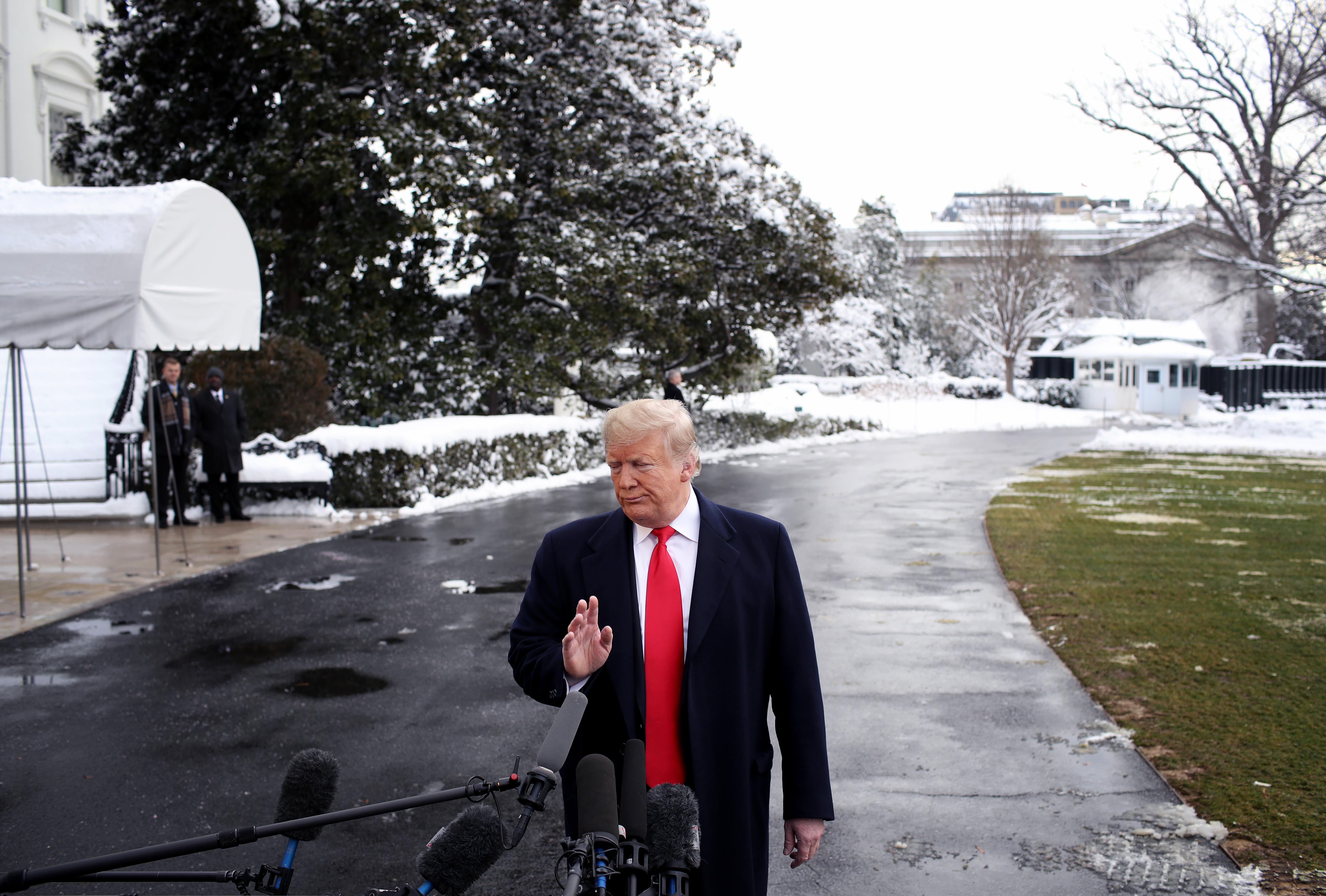 WASHINGTON, DC - JANUARY 14: U.S. President Donald Trump answers questions from the press as he departs the White House January 14, 2019 in Washington, DC. Trump is scheduled to travel to New Orleans today to address the American Farm Bureau Federation's 100th annual convention. (Photo by Win McNamee/Getty Images)