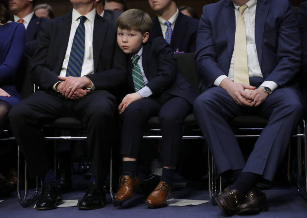 WASHINGTON, DC - JANUARY 15: Liam Daly, grandson of U.S. Attorney General nominee William Barr, listens as Barr testifies at his confirmation hearing before the Senate Judiciary Committee January 15, 2019 in Washington, DC. Barr, who previously served as Attorney General under President George H. W. Bush, was confronted about his views on the investigation being conducted by special counsel Robert Mueller. (Photo by Chip Somodevilla/Getty Images)