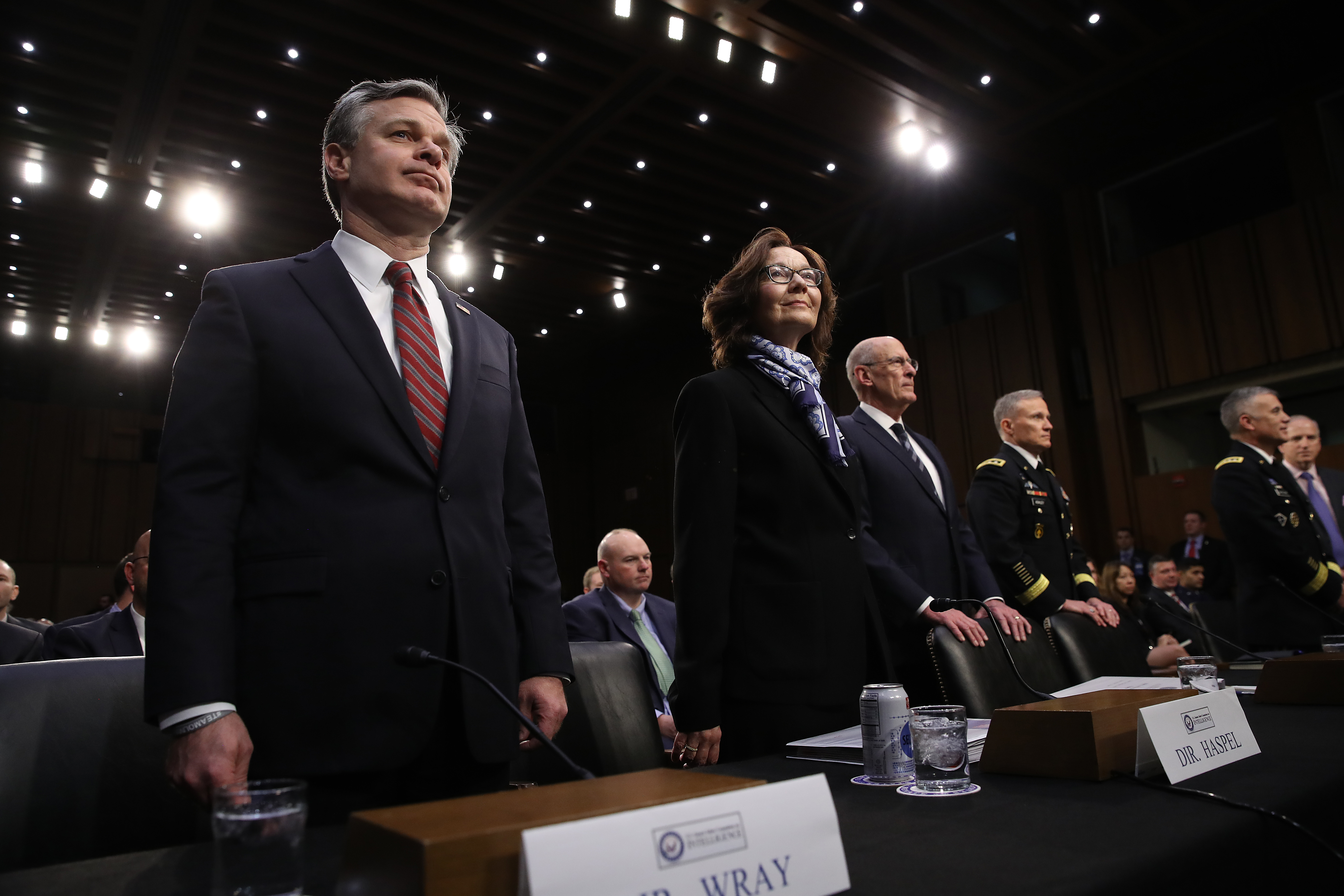 """FBI Director Christopher Wray; CIA Director Gina Haspel; Director of National Intelligence Dan Coats; Gen. Robert Ashley, director of the Defense Intelligence Agency; Gen. Paul Nakasone, director of the National Security Agency; and Robert Cardillo, director of the National Geospatial-Intelligence Agency await the start of a Senate Intelligence Committee hearing on """"Worldwide Threats"""" January 29, 2019 in Washington, DC. (Photo by Win McNamee/Getty Images)"""