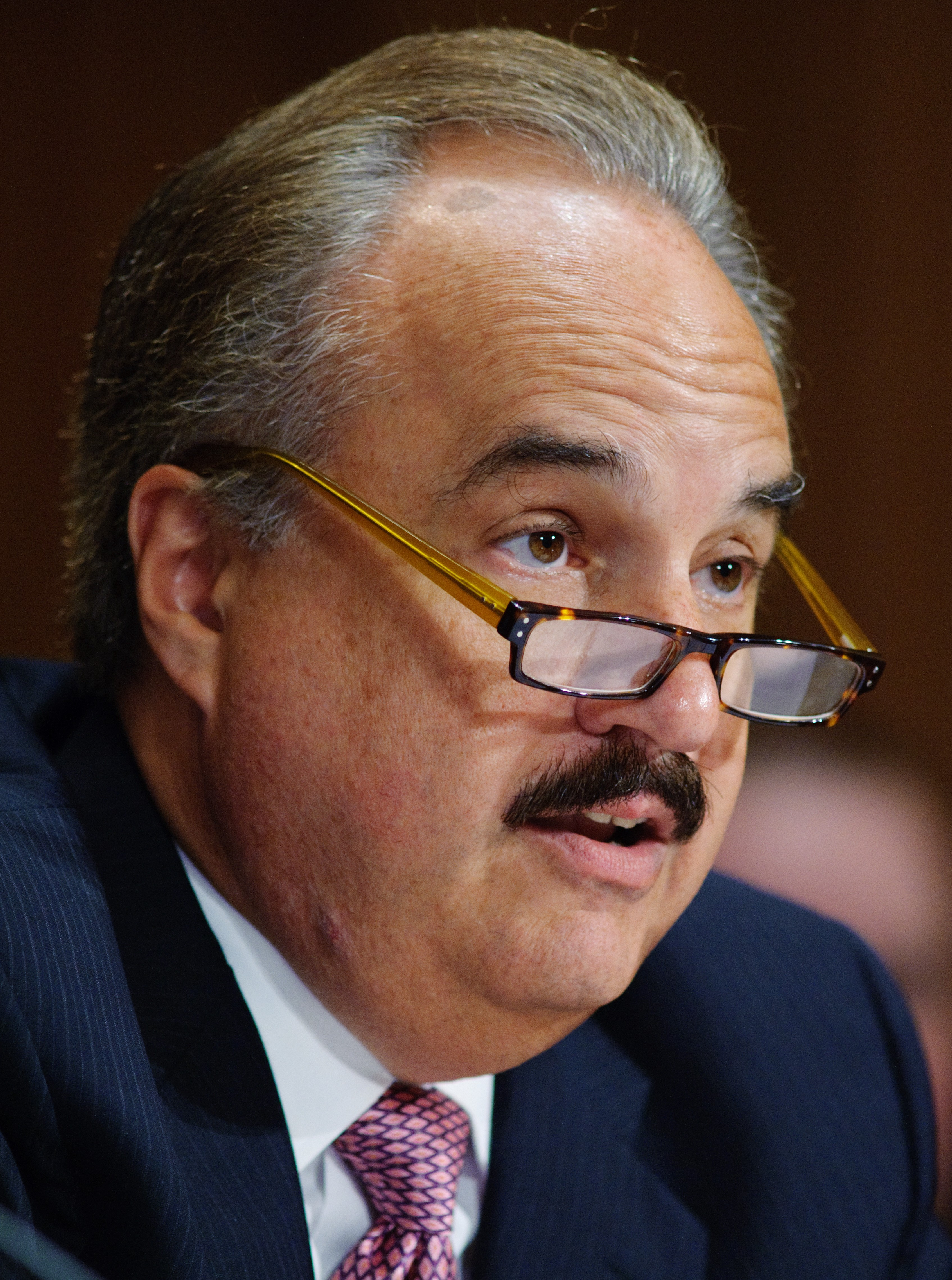 Larry Merlo, President and Chief Executive Officer, CVS Caremark Corporation, testifies before the Senate Finance Committee on the affect of the tax code on hiring, businesses and economic growth July 27, 2011 at the Dirksen Senate Office Building on Capitol Hill in Washington, DC. (MANDEL NGAN/AFP/Getty Images)
