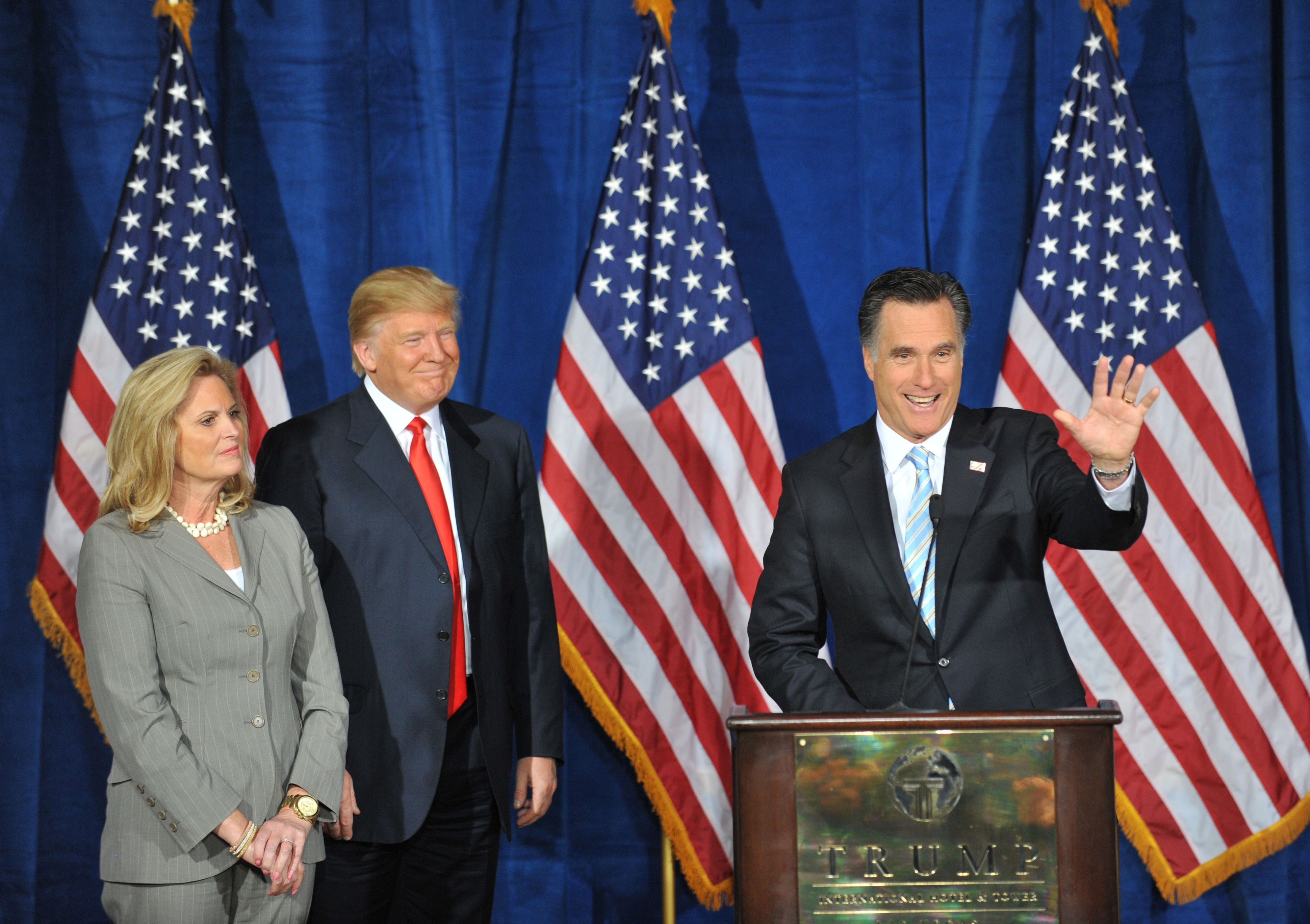Republican presidential hopeful Mitt Romney (R), with wife Ann (L), speaks after being endorsed by Donald Trump (C) at Trump International Hotel & Tower on February 2, 2012 in Las Vegas, Nevada ahead of the February 4 Nevada caucus. AFP PHOTO/Stan HONDA