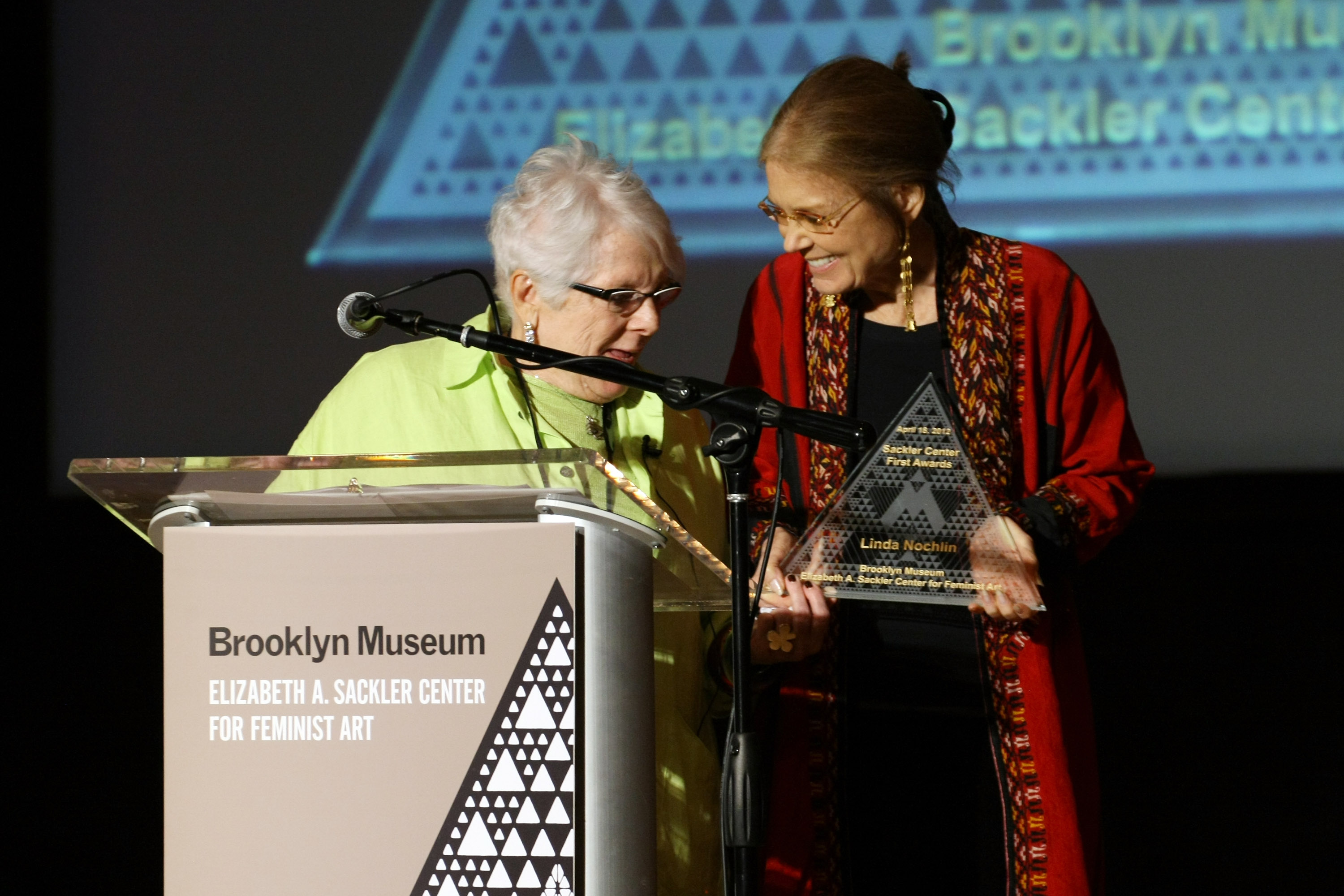 Art historian and honoree Linda Nochlin (L) is presented an award on stage by Gloria Steinem during the Brooklyn Museum's Sackler Center First Awards at the Brooklyn Museum on April 18, 2012 in the Brooklyn borough of New York City. (Photo by Neilson Barnard/Getty Images)
