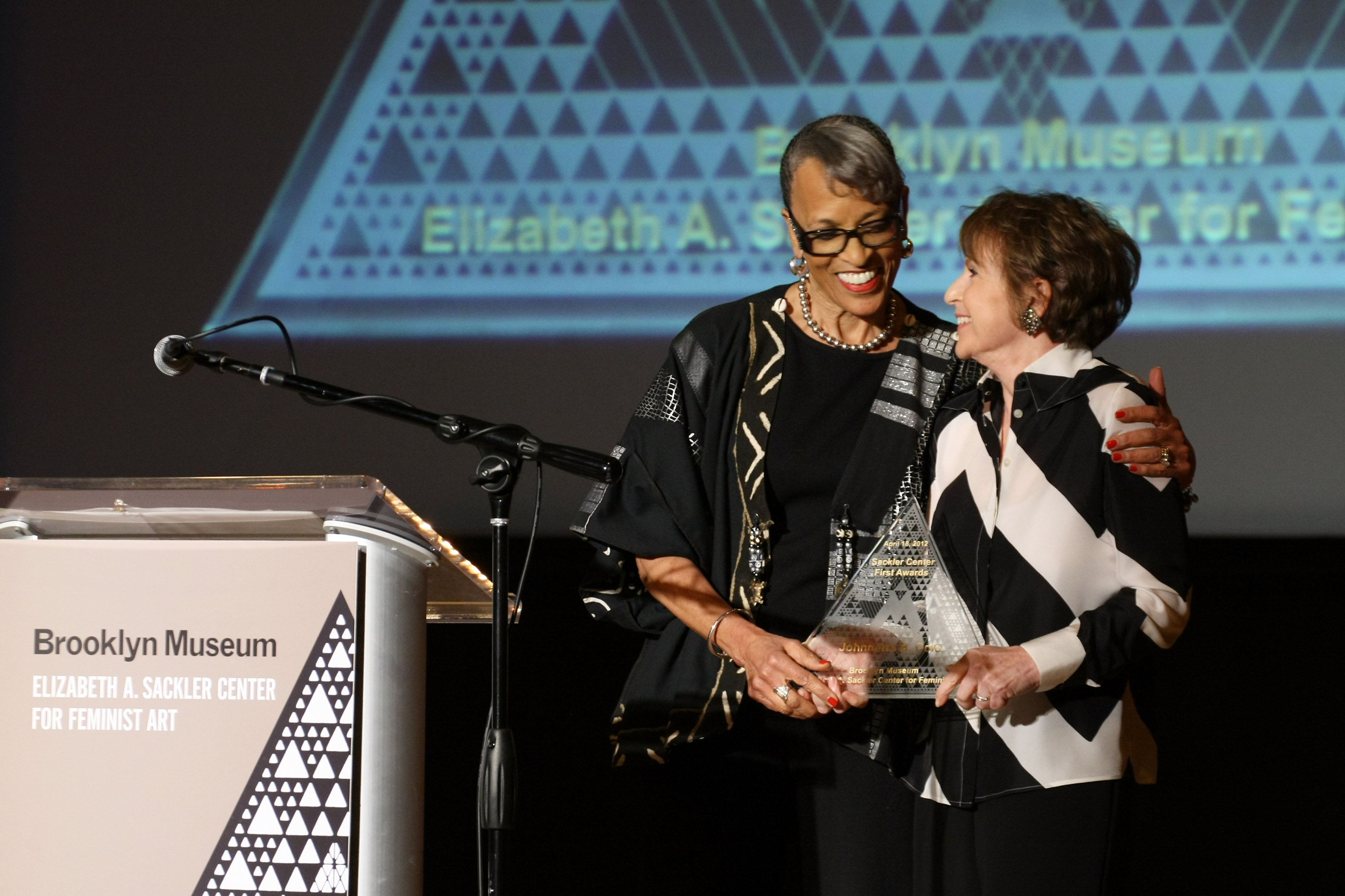 Director of Smithsonian's National Museum of African Art and honoree Dr. Johnnetta B. Cole (L) is presented an award on stage by Elizabeth A. Sackler during the Brooklyn Museum's Sackler Center First Awards at the Brooklyn Museum on April 18, 2012 in the Brooklyn borough of New York City. (Photo by Neilson Barnard/Getty Images)