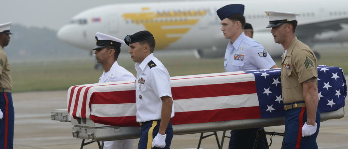 U.S. soldiers carry a U.S. flag draped casket containing what is believed to be remains of a US service man listed as missing in action during the Vietnam war, at a MIA (missing in action) repatriation ceremony held at Hanoi's Noi Bai airport on Nov. 30, 2012. (Photo: Getty Images/ AFP PHOTO / HOANG DINH Nam )