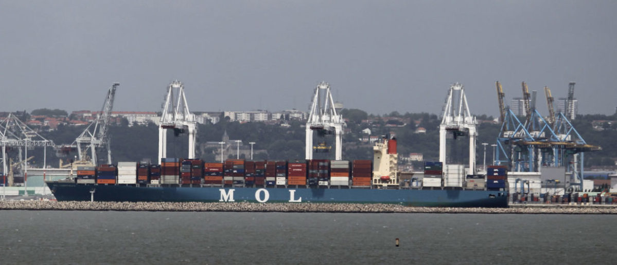 A picture taken on June 24, 2013 shows the Mol Competence container ship docked in the port of Le Havre, western France. French ecologist NGO Robin des Bois (Robin Hood) asked on June 24 to the port of Le Havre's inspectors of the maritime security to immobilize the Mol Competence ship because of possible risks. The Mol Competence is identical to the merchant vessel Mol Comfort, owned by Japan's Mitsui OSK Lines, which broke its hull into two off the Yemeni coast last June 17. AFP PHOTO CHARLY TRIBALLEAU
