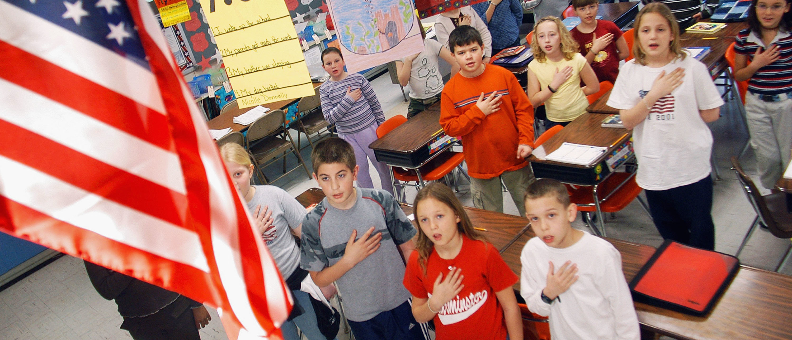 Fourth graders at Longstreth Elementary School pledge allegiance to the flag March 24, 2004 in Warminster, Pennsylvania. (Photo by William Thomas Cain/Getty Images)