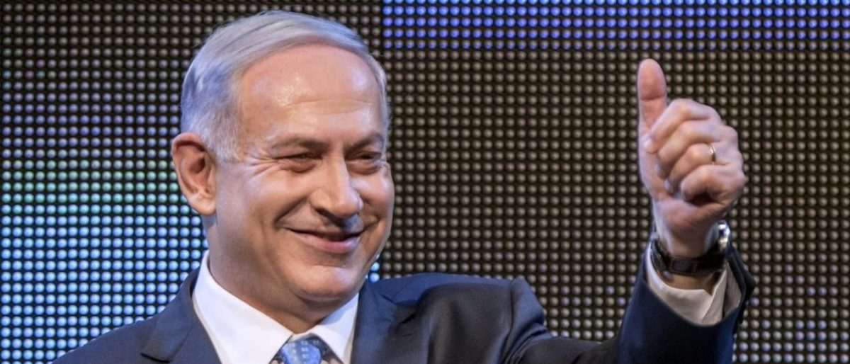 Israeli Prime Minister and leader of the ruling rightwing Likud party, Benjamin Netanyahu gestures as he gives a speech during a campaign meeting ahead of the early elections for the 20th Knesset on January 5, 2014 in the coastal Israeli city of Tel Aviv. The general elections, to be held on March 17, 2015 had been due in late 2017, but Netanyahu brought the polls forward after the collapse of his fractious coalition in early December. Primary elections of Likud party took place on December 31 ahead of the early elections, in which Netanyahu, in power since 2009, will seek to win a third straight term and a fourth in total. AFP PHOTO / JACK GUEZ