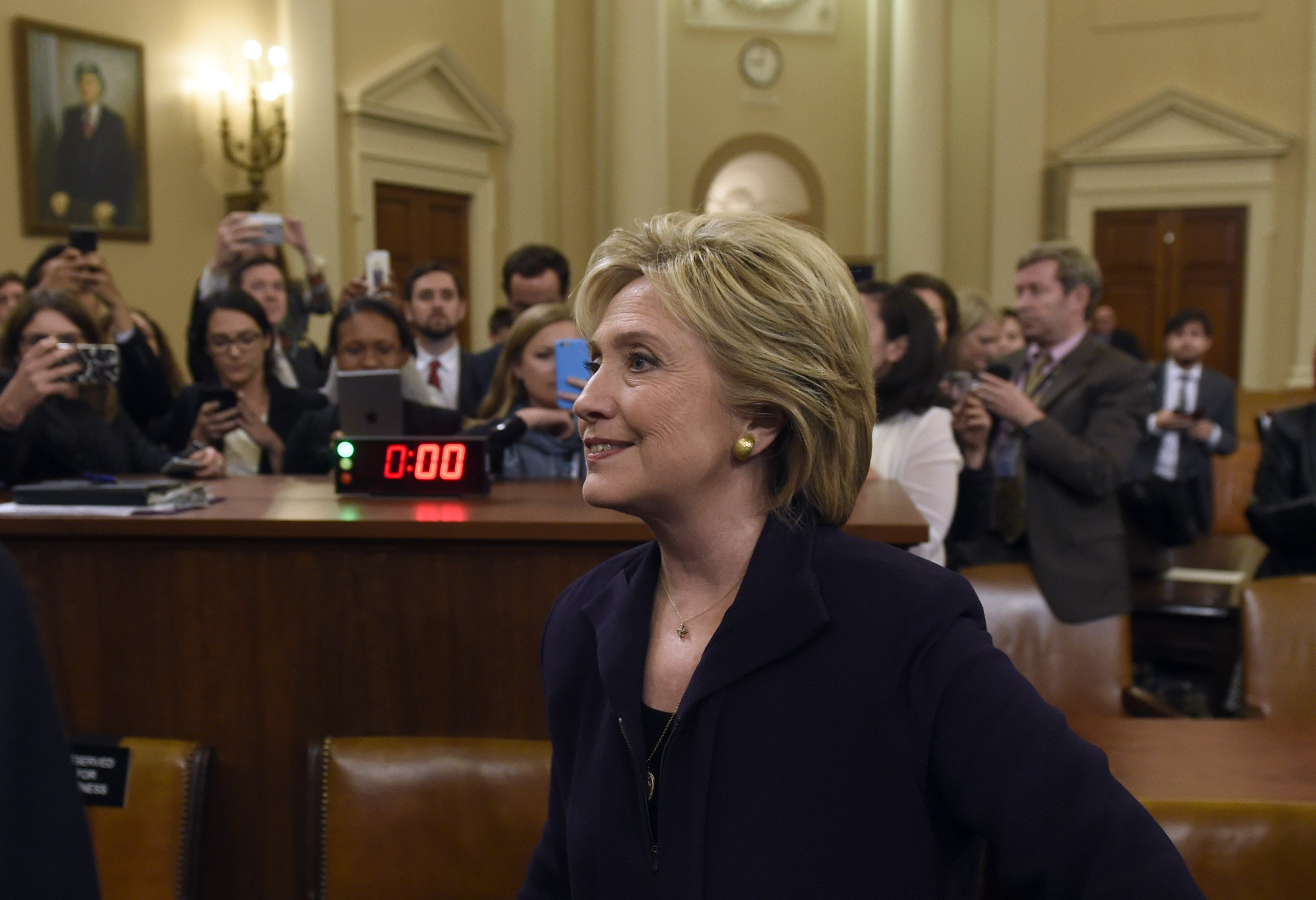 Former Secretary of State and Democratic Presidential hopeful Hillary Clinton leaves after she testified before the House Select Committee on Benghazi on Capitol Hill in Washington, DC, October 22, 2015. (SAUL LOEB/AFP/Getty Images)