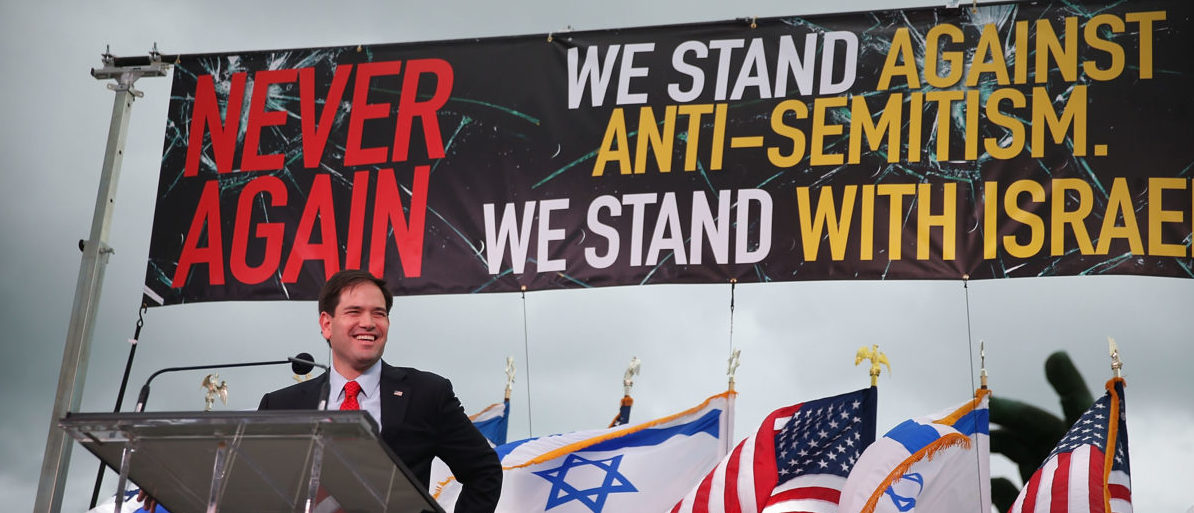 """MIAMI BEACH, FL - NOVEMBER 15: Republican presidential candidate Sen. Marco Rubio (R-FL) speaks during a community rally for """"Never Again"""" which was bringing attention to what the organizers say is a rise in worldwide anti-Semitism and the campaign against Israel's right to exist on November 15, 2015 in Miami Beach, Florida. (Joe Raedle/Getty Images)"""