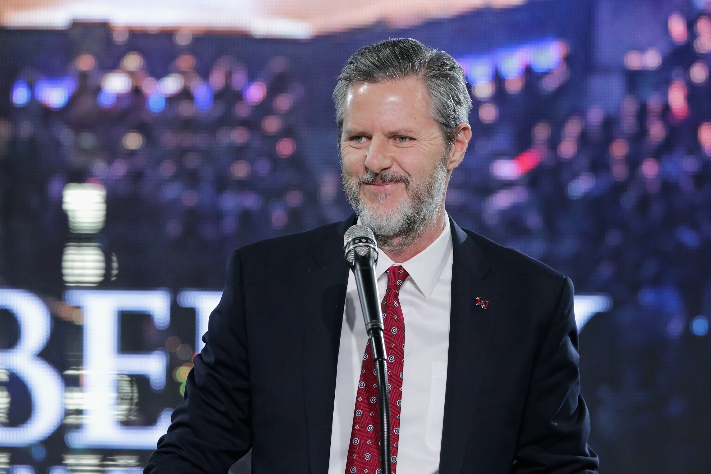 "LYNCHBURG, VA - JANUARY 18: Liberty University President Jerry Falwell, Jr. introduces Republican presidential candidate Donald Trump with a sports jersey after he delivered the convocation in the Vines Center at the university January 18, 2016 in Lynchburg, Virginia. Although Falwell said the university does not endorse a particular candidate, he left no question as to who he is supporting in the 2016 presidential race. Highlighting Trump's conservative credentials, charity and politically incorrect speech, Falwell said, ""I see a lot of parallels between my father and Donald Trump."" (Photo by Chip Somodevilla/Getty Images)"