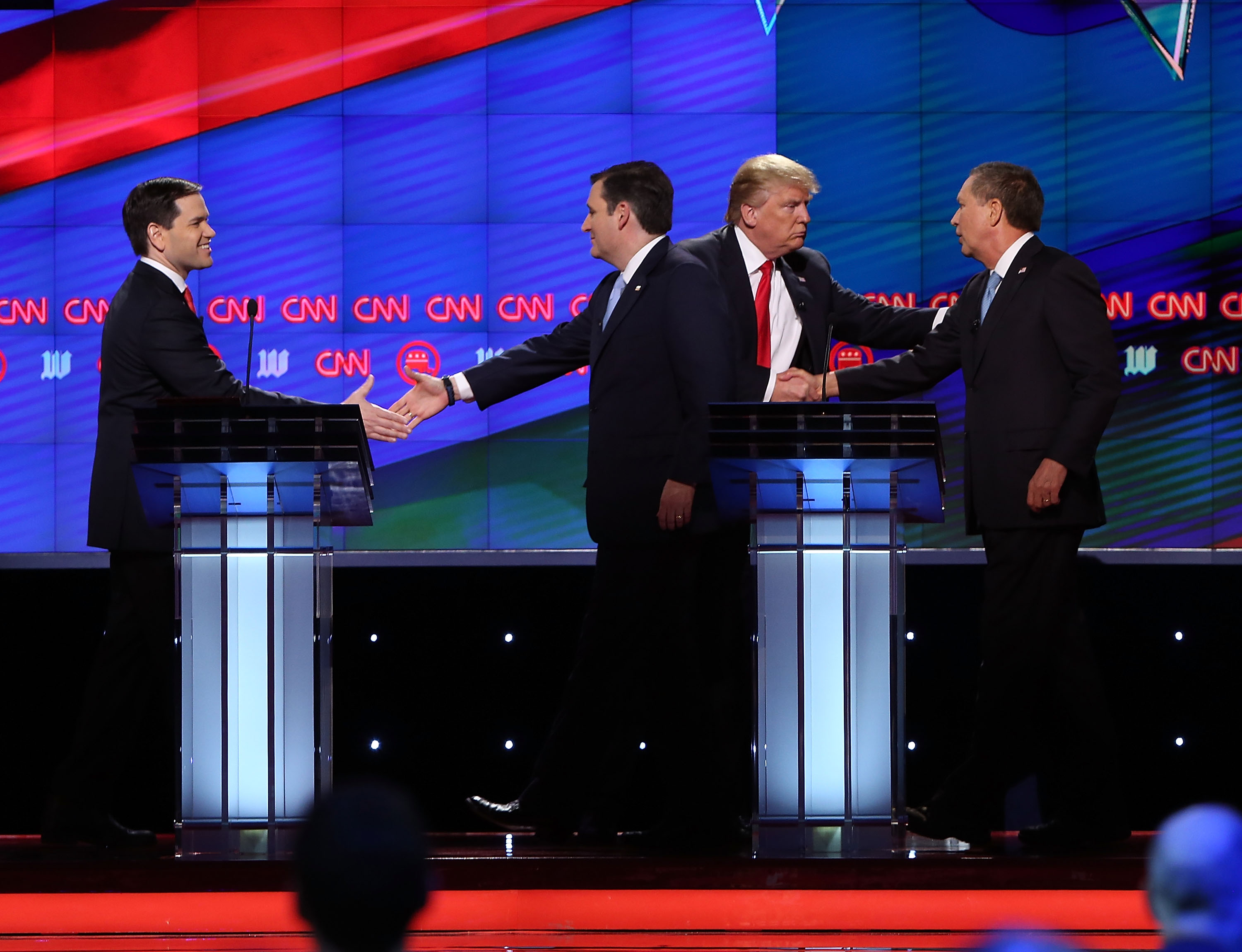 Republican presidential candidates, Sen. Marco Rubio, Sen. Ted Cruz, Donald Trump and Ohio Gov. John Kasich (L-R) shake hands at the end of their debate during the CNN, Salem Media Group, The Washington Times Republican Presidential Primary Debate on the campus of the University of Miami on March 10, 2016 in Coral Gables, Florida. (Photo by Joe Raedle/Getty Images)