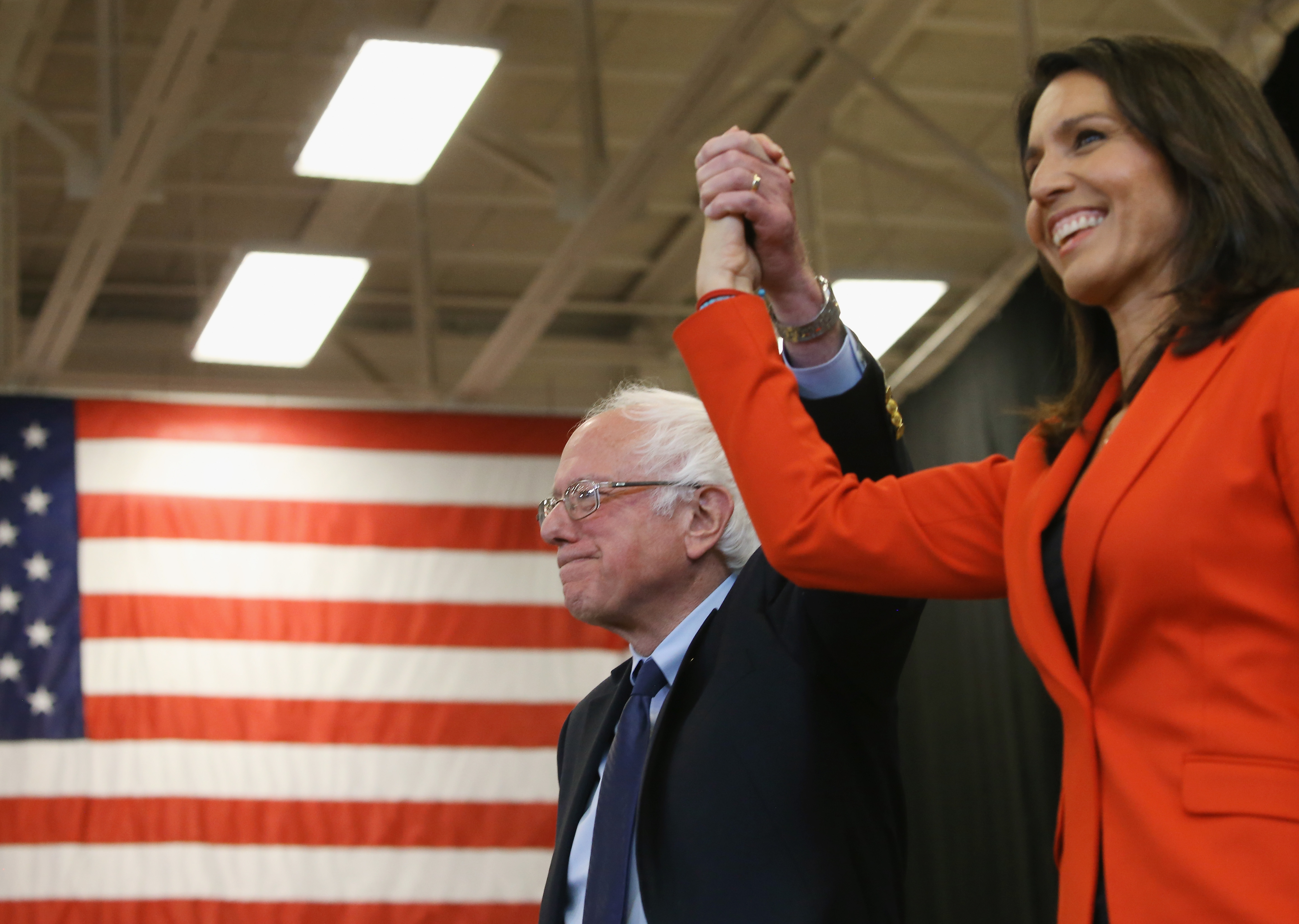 ETTYSBURG, PA - APRIL 22: Sen. Bernie Sanders (I-VT), is introduced to speak by Rep.Tulsi Gabbard, (D-HI),(R), during a campaign stop at the Bream Wright Hauser Athletic Complex at Gettysburg College, April 22, 2016 in Gettysburg, Pennsylvania. Pennsylvania will hold its 2016 primary election on Tuesday April 26th. (Photo by Mark Wilson/Getty Images)