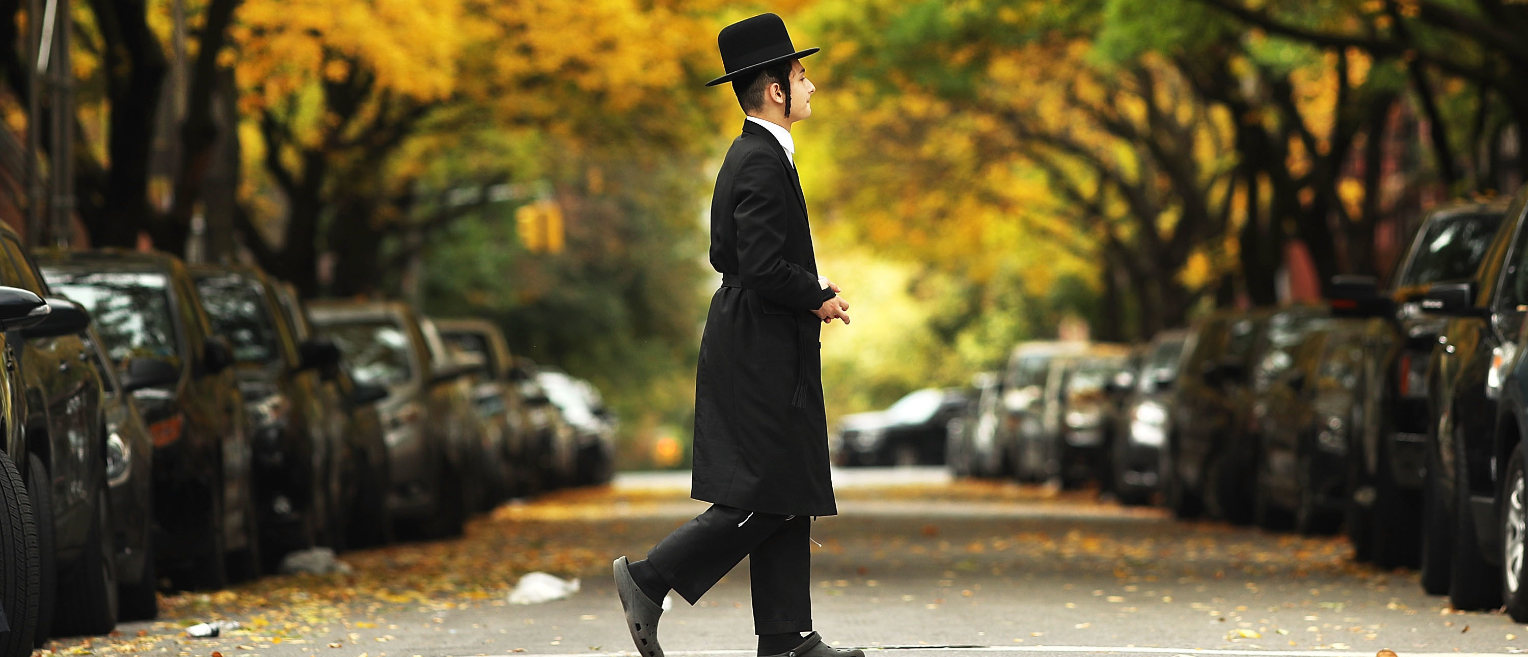A member of an Orthodox Jewish community in Williamsburg, Brooklyn walks through the neighborhood on Yom Kippur, one of the most important holidays of the Jewish year on October 12, 2016 in New York City.(Photo by Spencer Platt/Getty Images)