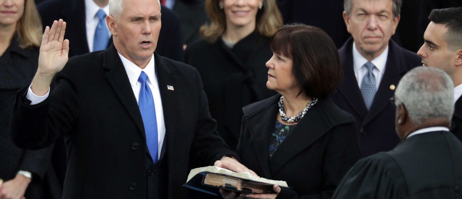 U.S. Vice President Mike Pence (L) takes the oath of office from Supreme Court Justice Clarence Thomas (R) as his wife Karen Pence holds the Bible, on the West Front of the U.S. Capitol on January 20, 2017 in Washington, DC.(Photo by Chip Somodevilla/Getty Images)