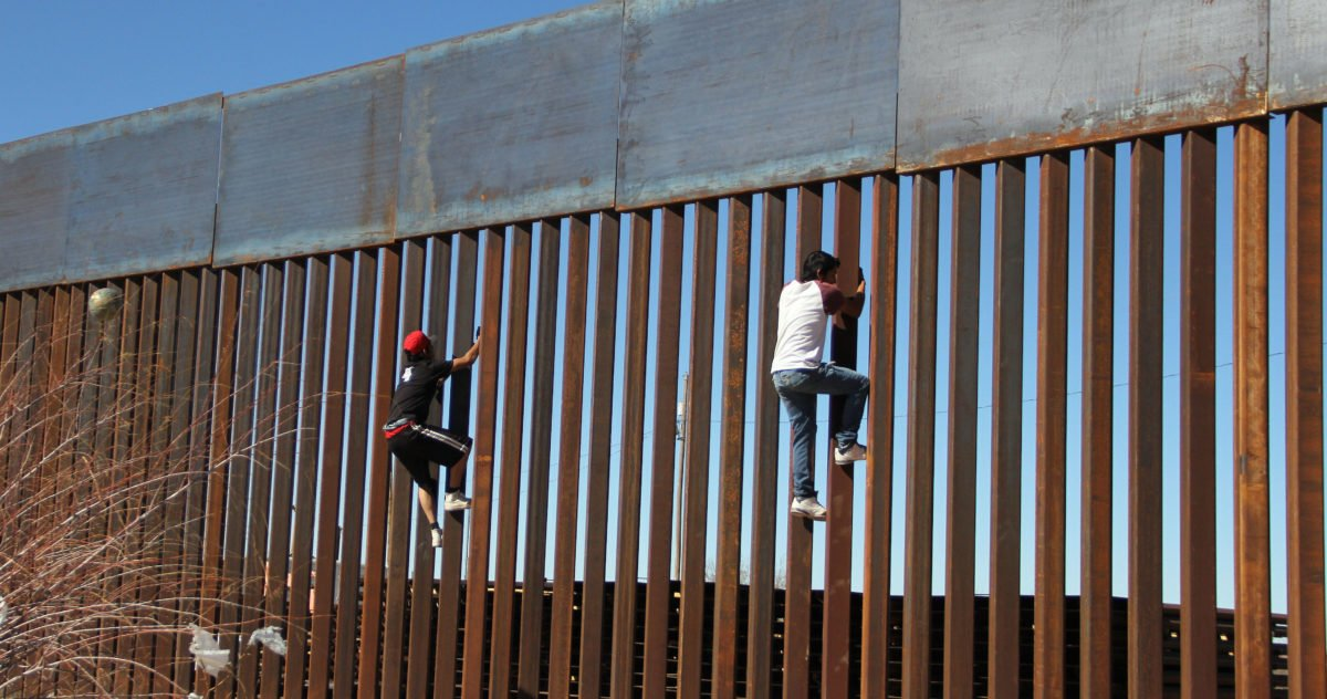 "Boys play around, climbing the border division between Mexico and the US in Ciudad Juarez, Mexico on January 26, 2017. US President Donald Trump on Thursday told Mexico's president to cancel an upcoming visit to Washington if he is unwilling to foot the bill for a border wall. Escalating a cross border war of words, Trump took to Twitter to publicly upbraid Enrique Pena Nieto. ""If Mexico is unwilling to pay for the badly needed wall, then it would be better to cancel the upcoming meeting."" / AFP / HERIKA MARTINEZ (Photo credit should read HERIKA MARTINEZ/AFP/Getty Images)"