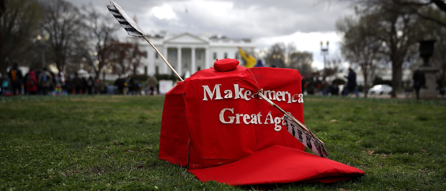 "WASHINGTON, DC - MARCH 10: An oversized replica of a ""Make America Great Again"" hat sits on the grass across from the White House during a demonstration against the Dakota Access Pipeline on March 10, 2017 in Washington, DC. Thousands of protesters and members of Native nations marched in Washington DC to oppose the construction of the proposed 1,172 Dakota Access Pipeline that runs within a half-mile of the Standing Rock Sioux reservation in North Dakota. (Photo by Justin Sullivan/Getty Images)"
