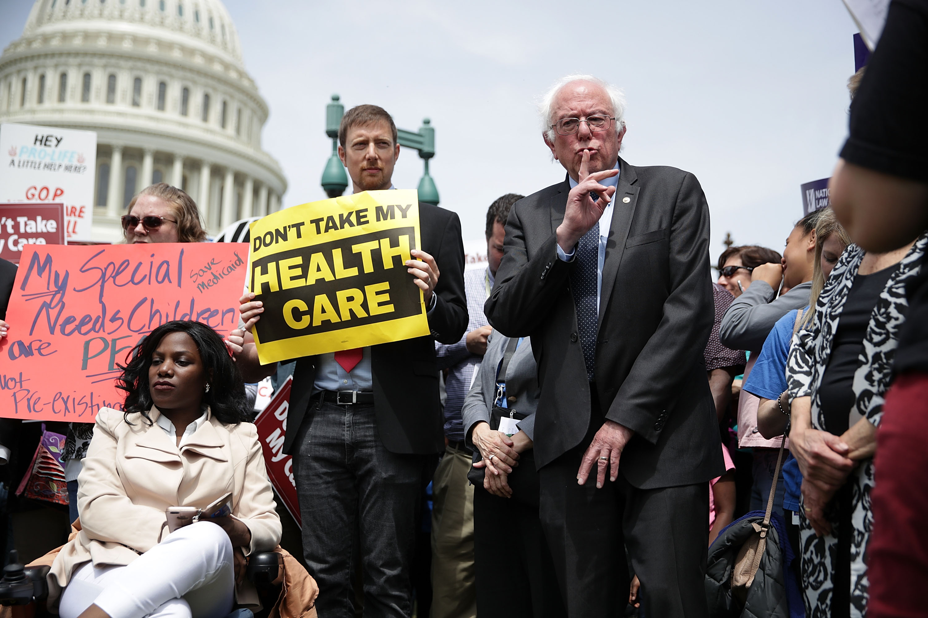 U.S. Sen. Bernie Sanders (I-VT) signals the crowd to quiet down for a speaker during a Stop 'Trumpcare' rally May 4, 2017 in front of the Capitol in Washington, DC. Congressional Democrats joined activists for a rally to urge not to replace Obamacare, also known as the Affordable Care Act. (Photo by Alex Wong/Getty Images)