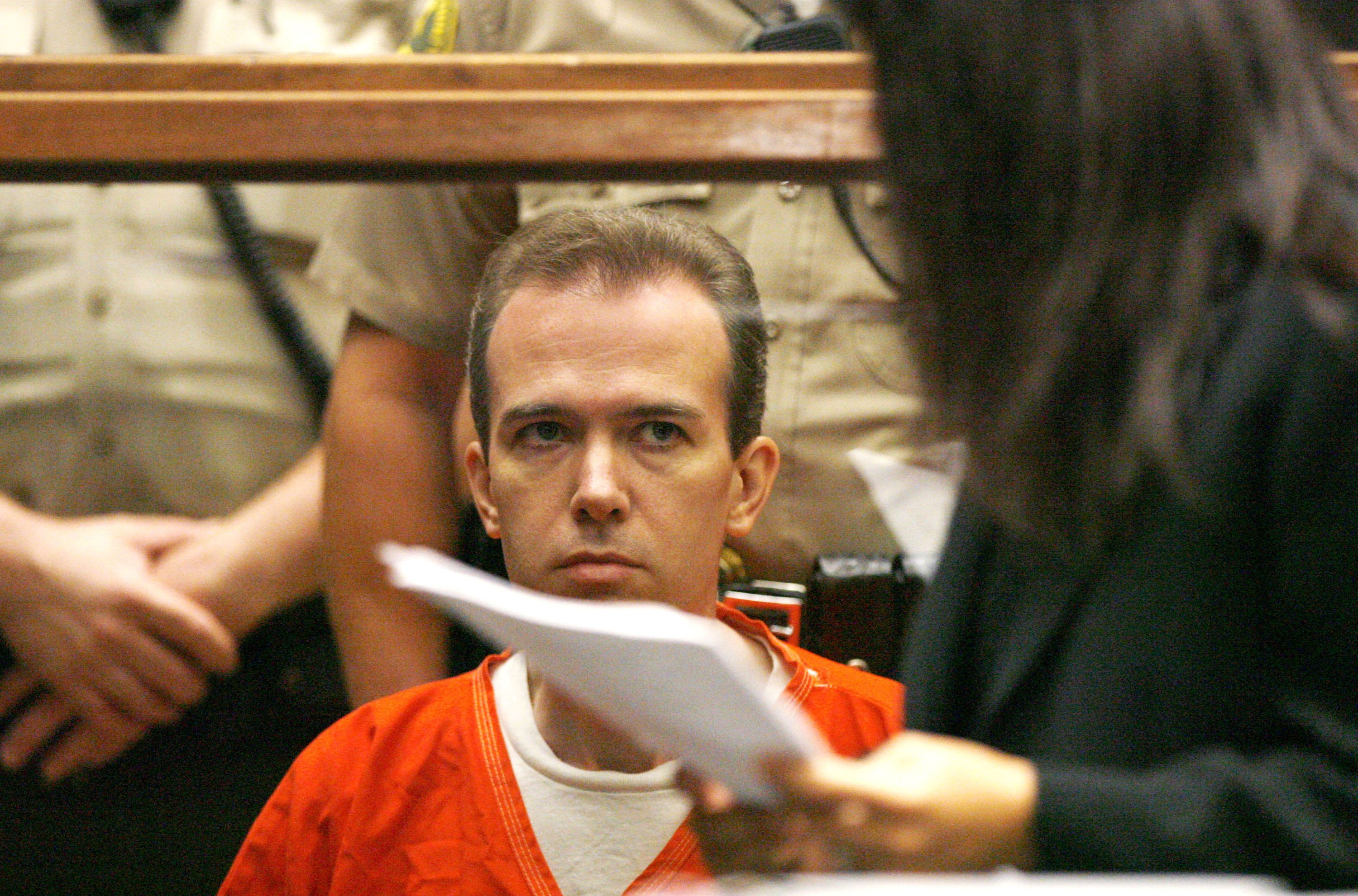 John Mark Karr, the suspect in the killing of child beauty queen JonBenet Ramsey, looks at deputy public defender Haydeh Takasugi during an extradition hearing at the Los Angeles Superior Court August 22, 2006 in Los Angeles, California. (Photo by Mario Anzuoni-Pool/Getty Images)