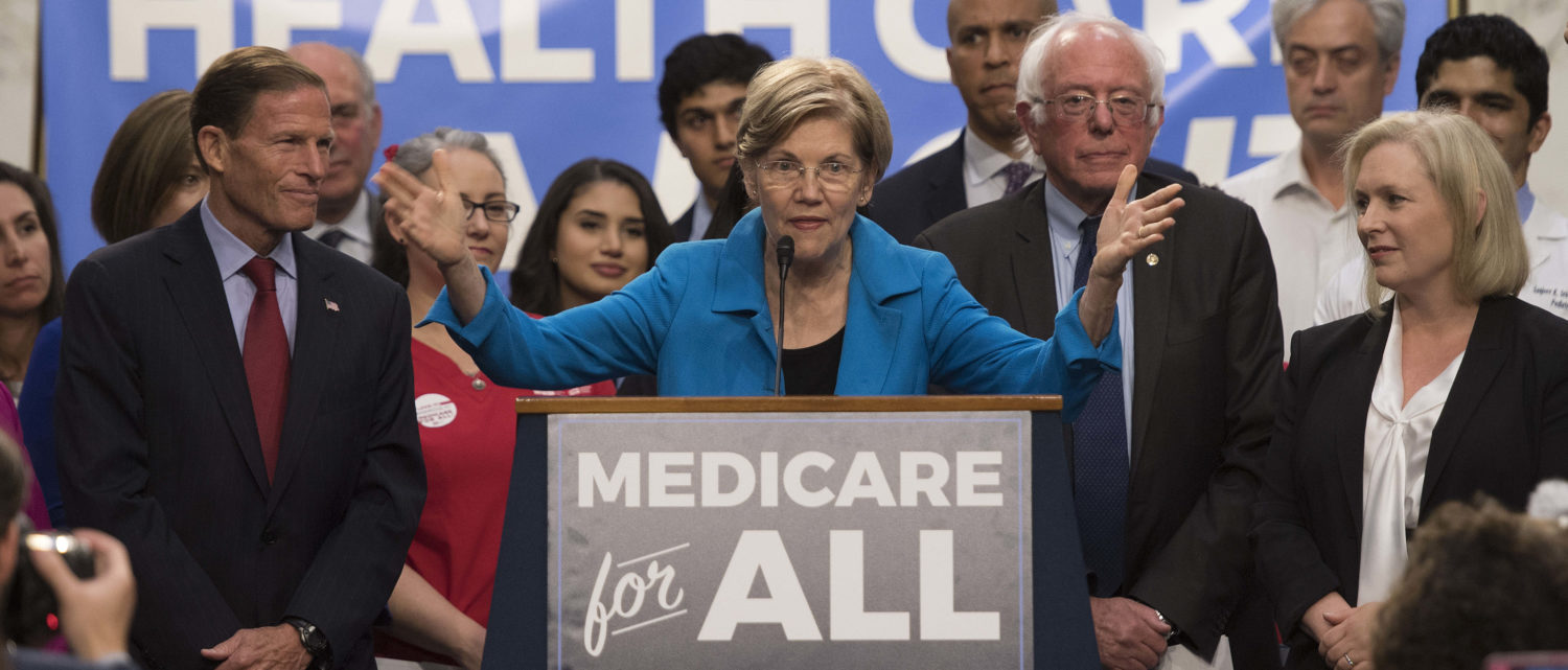 US Senator Elizabeth Warren (C), Democrat from Massachusetts, speaks with US Senator Bernie Sanders (2nd R), Independent from Vermont, as they discusses Medicare for All legislation / AFP PHOTO / JIM WATSON (Photo credit should read JIM WATSON/AFP/Getty Images)