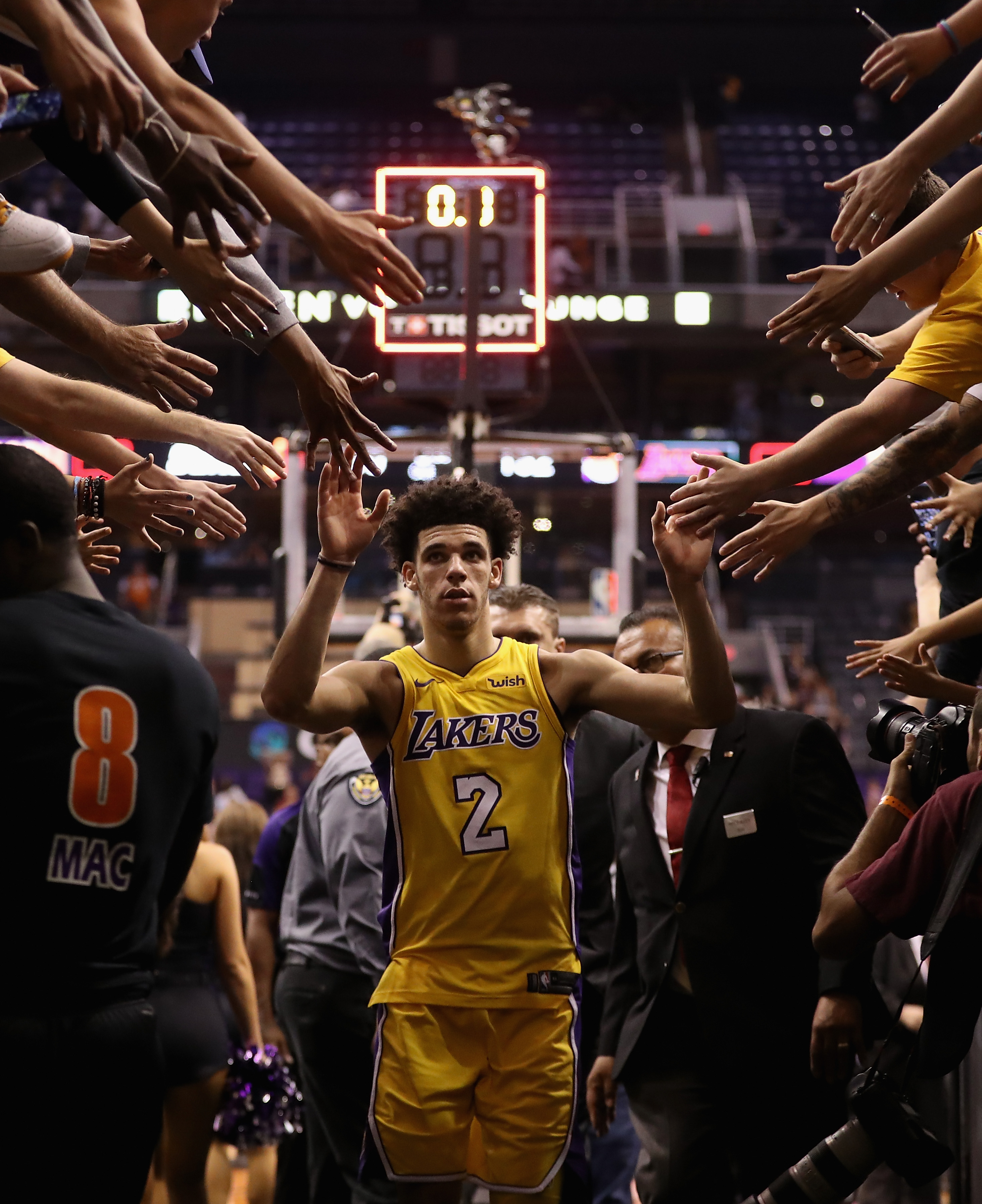PHOENIX, AZ - OCTOBER 20: Lonzo Ball #2 of the Los Angeles Lakers high fives fans as he walks off the court following the NBA game against the Phoenix Suns at Talking Stick Resort Arena on October 20, 2017 in Phoenix, Arizona. (Photo by Christian Petersen/Getty Images)