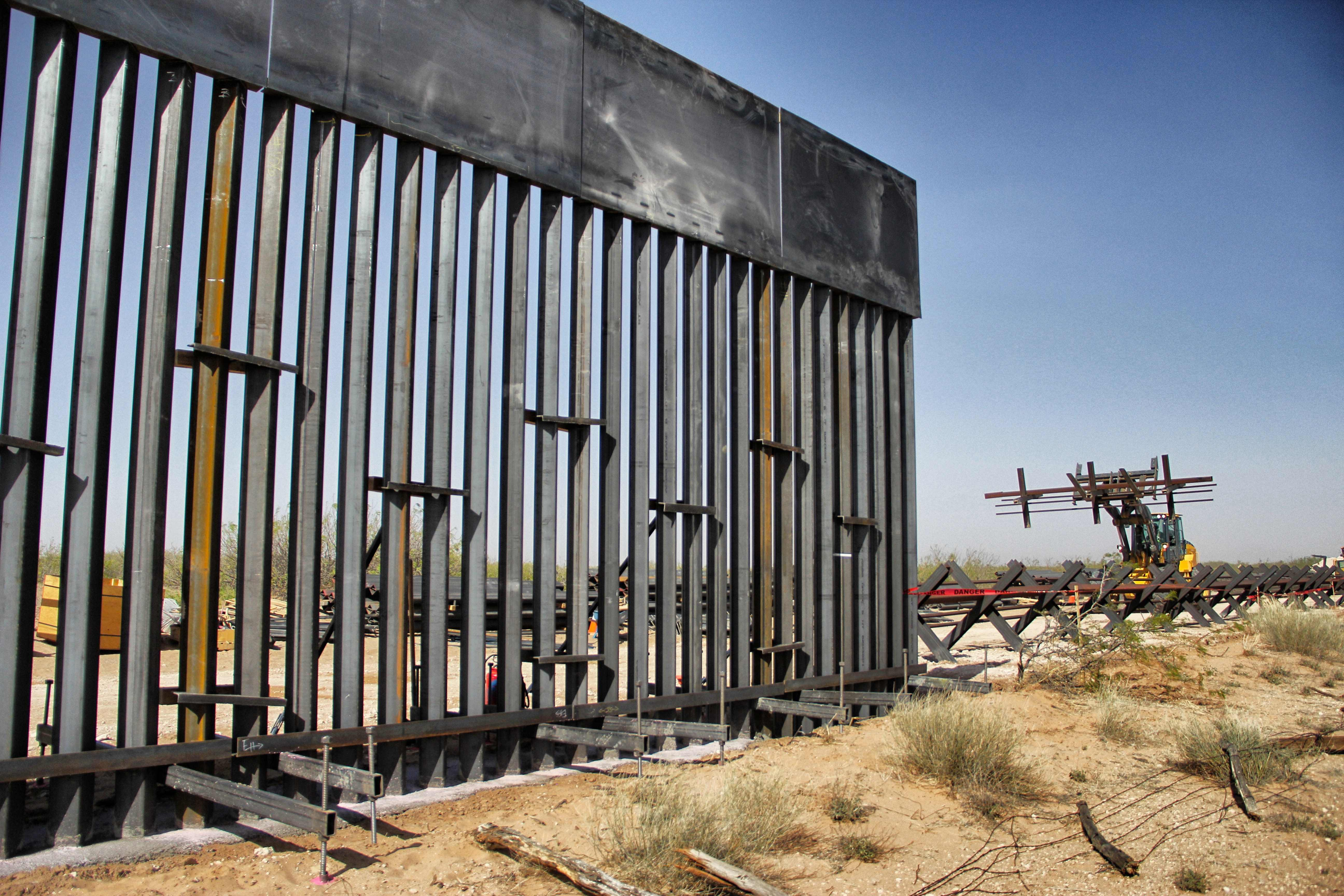 US workers are photographed during construction of 32km of the border wall by order of US President Donald Trump on the border between Ciudad Juarez, Chihuahua state, Mexico and Santa Teresa, New Mexico state, US, on April 17, 2018. (HERIKA MARTINEZ/AFP/Getty Images)