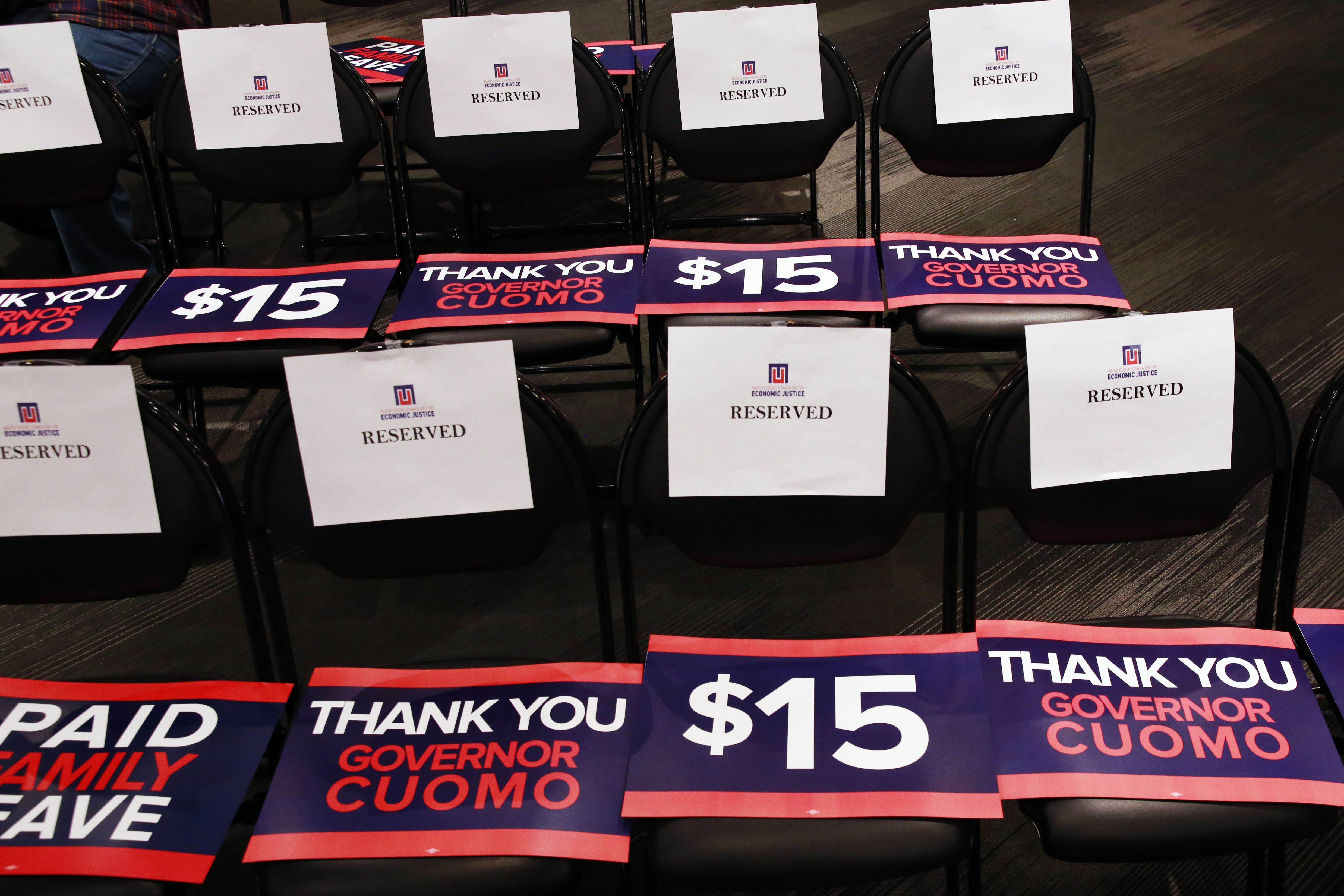 Signs rest on chairs before a rally to celebrate the state of New York passing into law a $15 minimum wage in New York April 4, 2016. REUTERS/Lucas Jackson