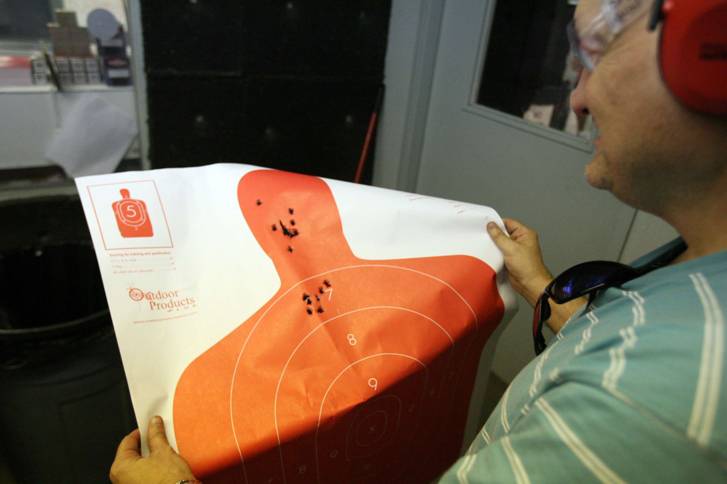 John Sanders of Irving, TX, checks his target after shooting his glock pistol June 26th at the DFW Gun Range and Training Center in Dallas, Texas. (Rick Gershon/Getty Images)